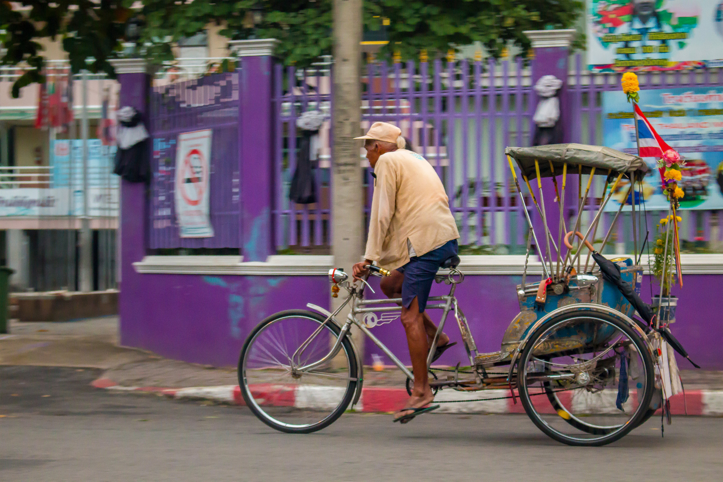 Bicyclist riding through the streets of Chiang Mai, Thailand