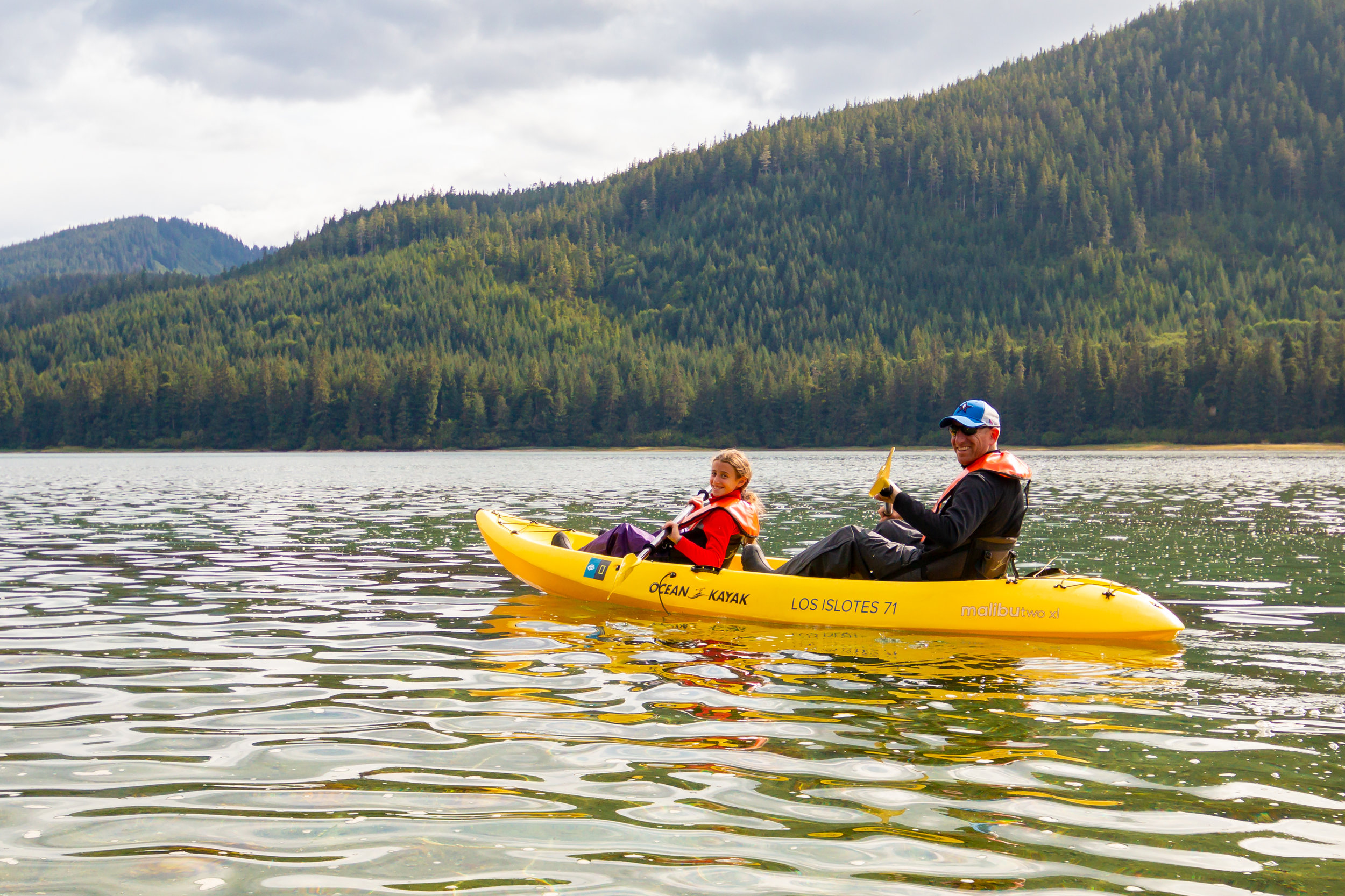 Father and daughter kayaking in Sitkoh Bay, Southeast Alaska.