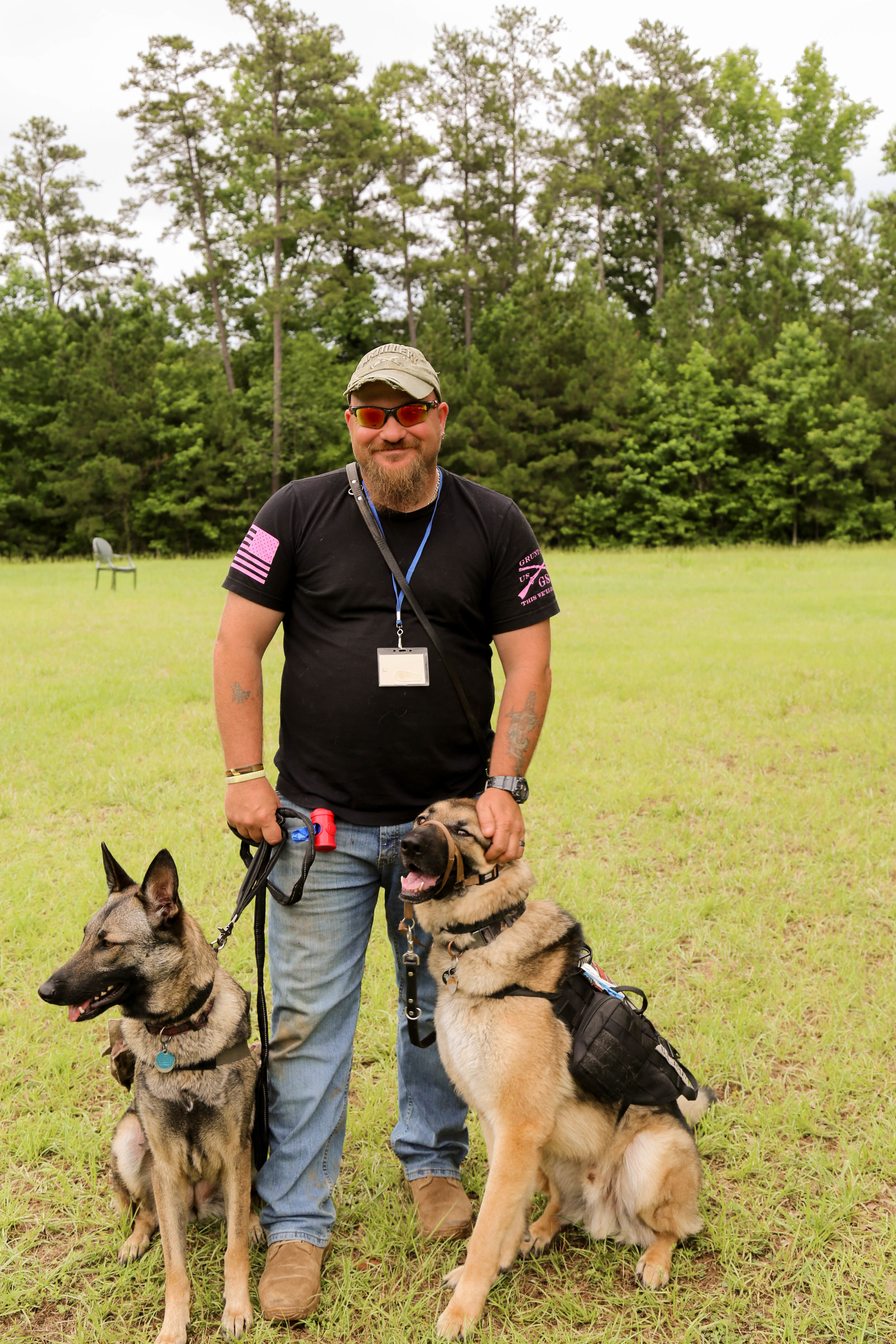 Jim with his service dogs.