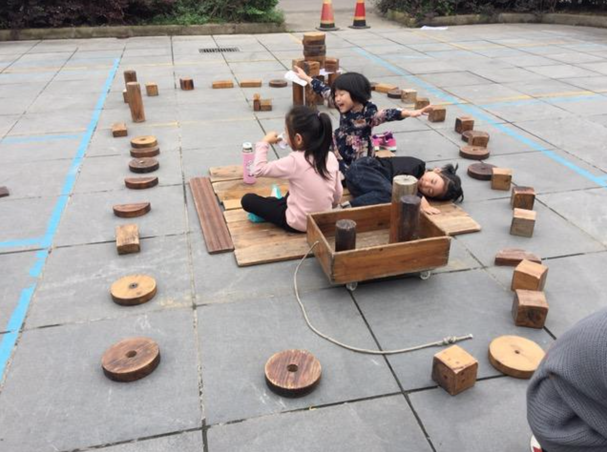 Mary Anne Kreshka: The enclosed private and personal space was created by the three girls following their plan—note the paper under the stacked blocks.