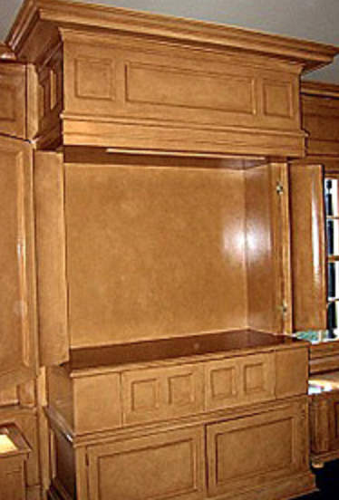 entertainment storage - This is a TV cabinet, built-in from crown molding to base, with special paint treatment and patinated hardware. I think if it didn't house a TV one might imagine it to be original to this huge 1920's house. I love the corner columns that hinge away.Getting a piece like this off the page, those first decisions regarding the size, scale and divisions of the carcass is where experience and bravery play a role. Even a drawing this detailed doesn't answer all questions. A piece of this quality is a pleasure and a challenge.
