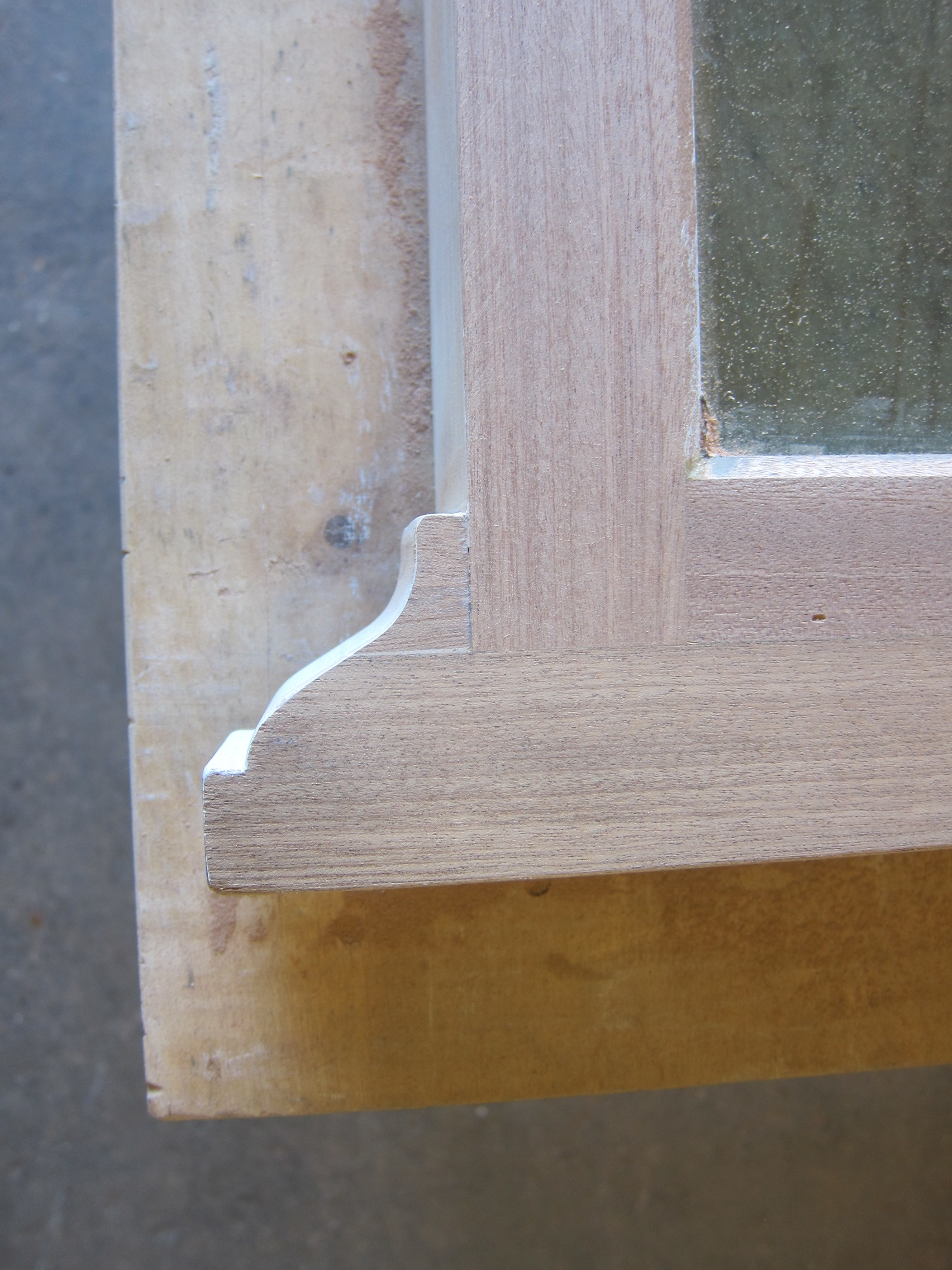 This close-up is the glazing stop bonded and sanded flush to house the insulating glass panels.