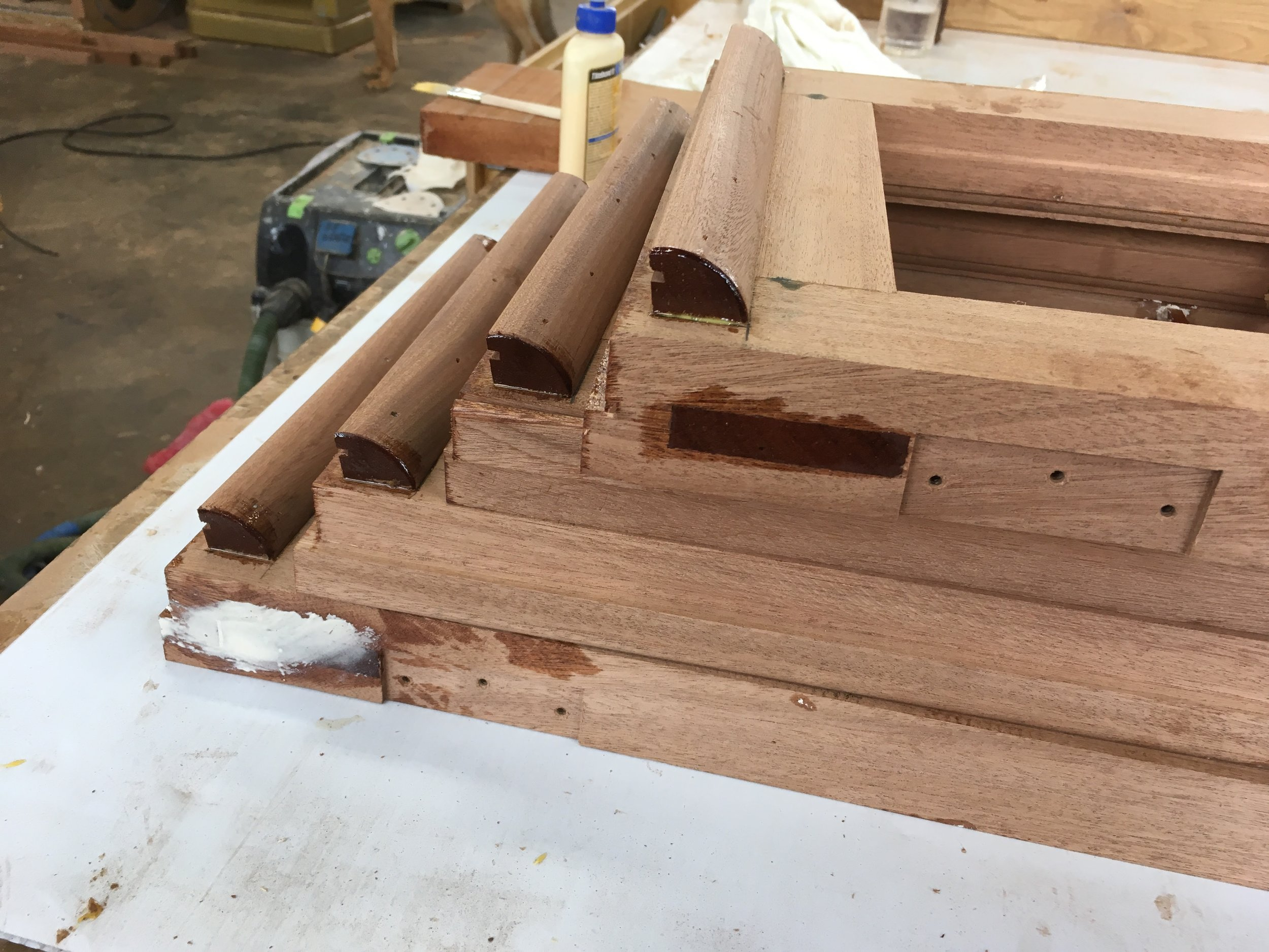 These mahogany sash reproductions receive a traditional drip edge molding and modern epoxy to seal end grain.