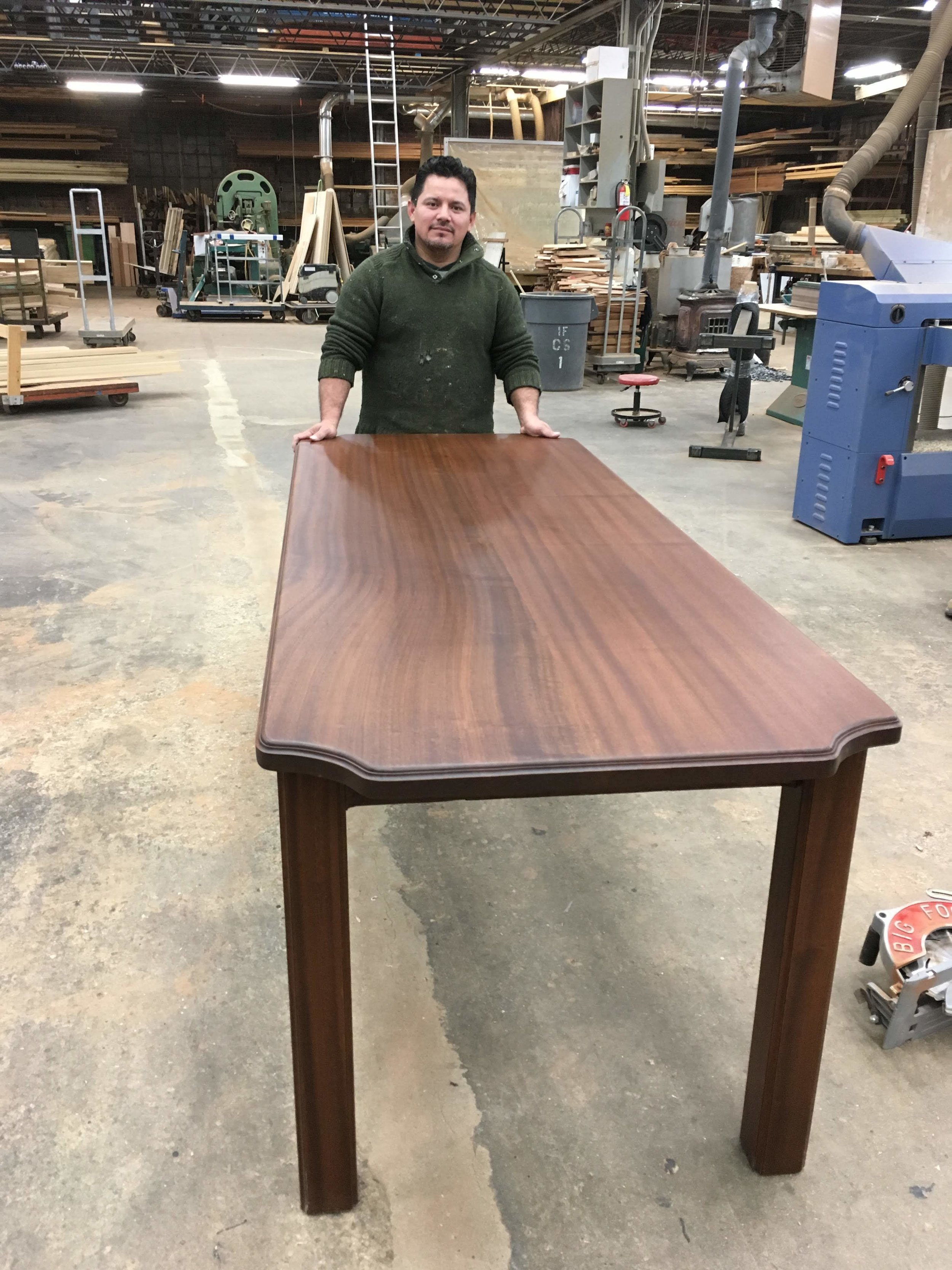 Hector and his new dining room table, all Sapele Mahogany.  We stock the Sapele in four thicknesses and buy in quantities that allow us to use this beautiful solid material freely.