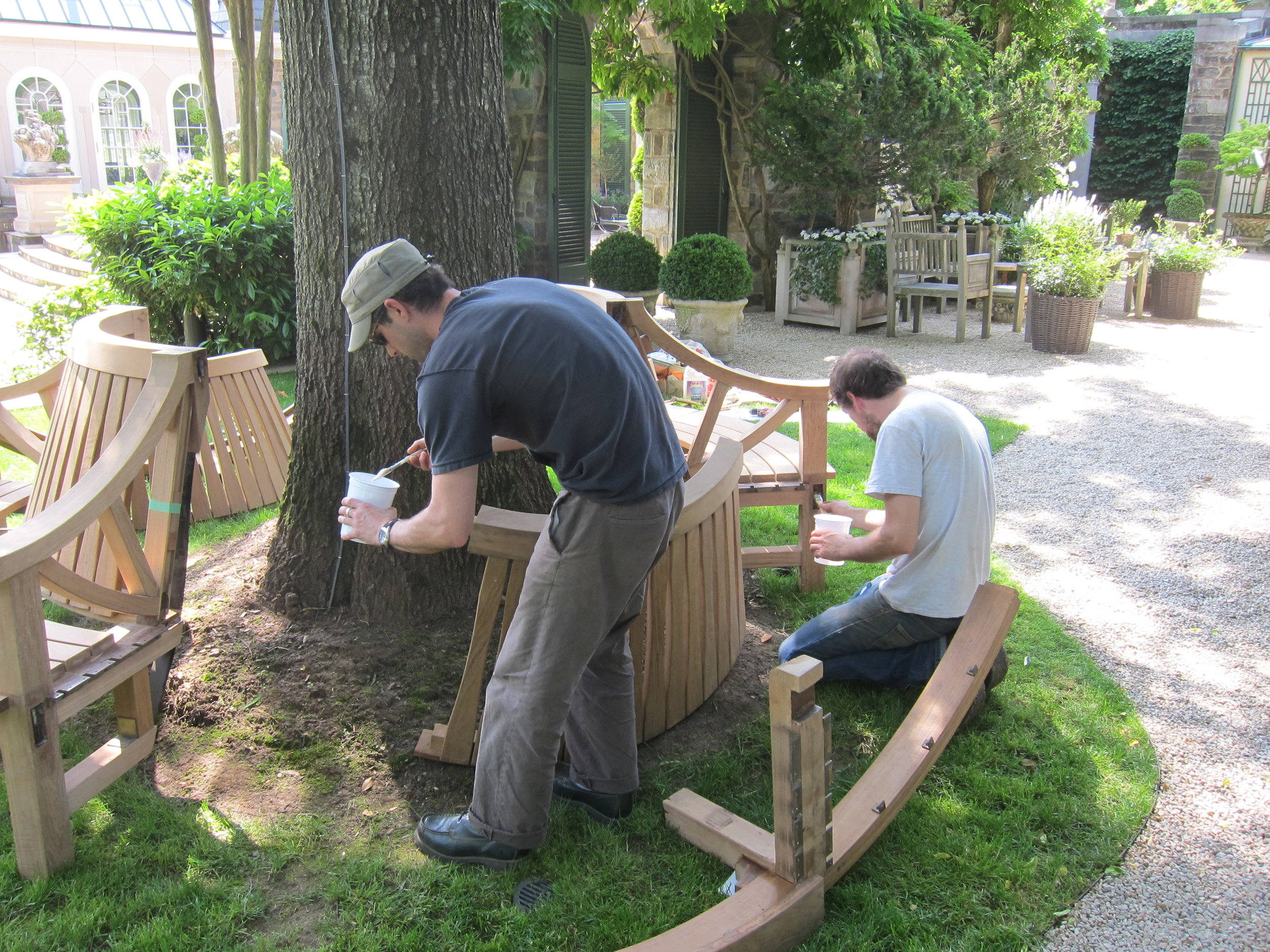 Assembly of bench surrounding tree.