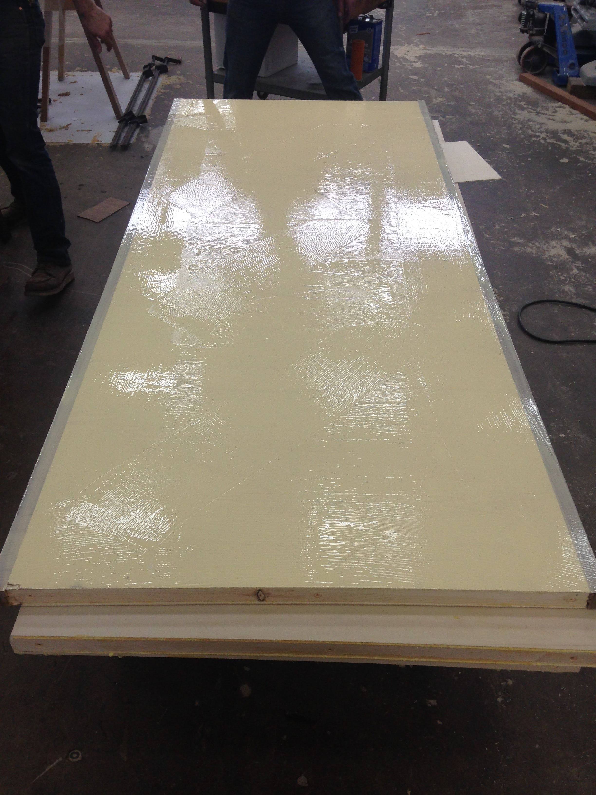 This door core with a coating of Titebond veneer-grade glue is ready for the press.