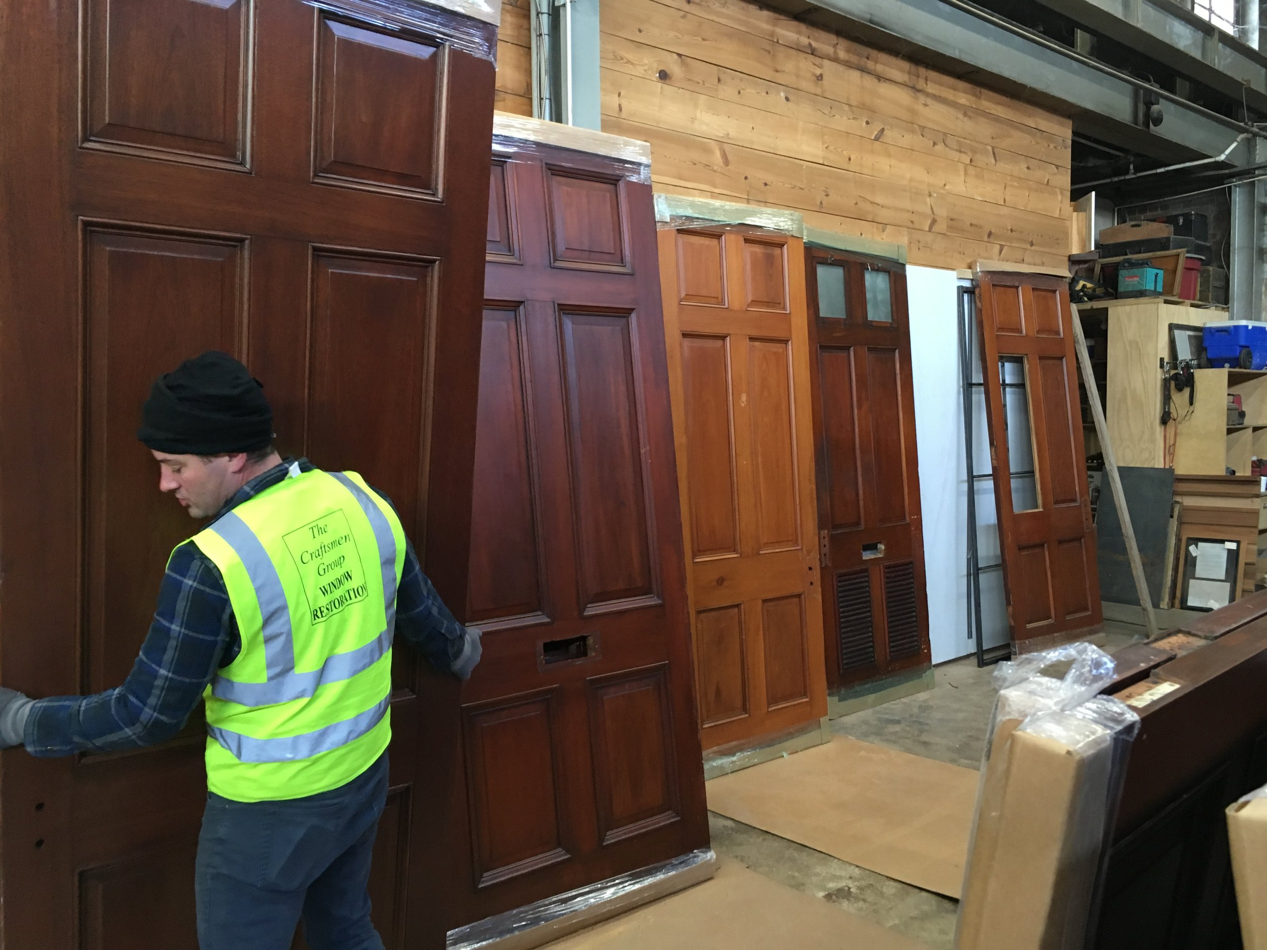 After 115 years of maintenance and neglect, the doors came to us in many shades of brown.  These handsome solid mahogany doors will certainly endure another 100 years after our restoration.