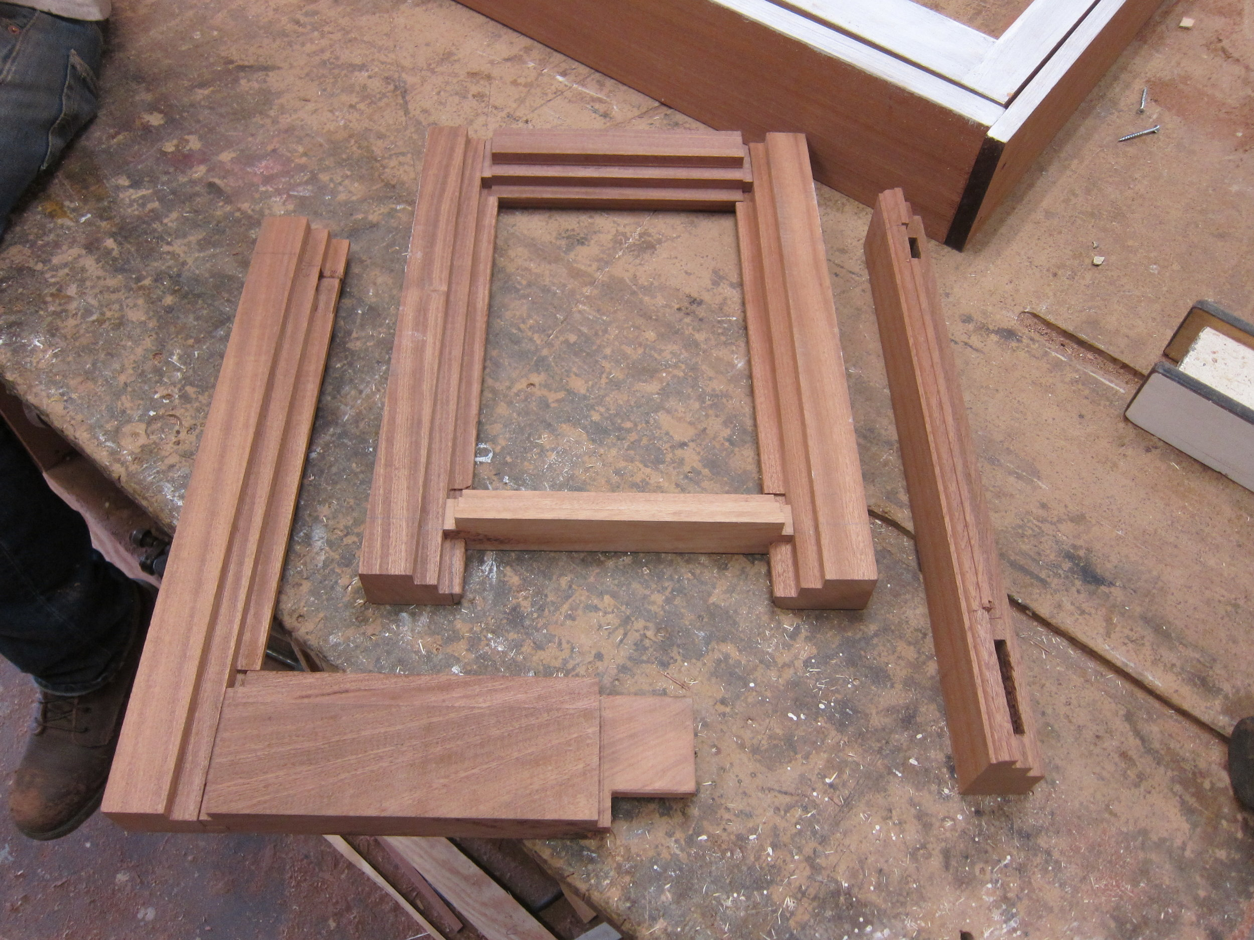 "An 1 3/4"" thick Sapele Mahogany sash with traditional joinery and profiles adapted for insulating glass.  We made 4,000 sash like this sample for the GSA headquarters.  The deeper relief for the insulating glass panels complicates joinery and assembly."