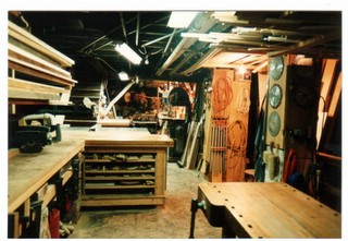 The original shop in the basement of an Adam's Morgan row house, 7-ft. ceilings and access through the dining room were among the many challenges of producing work here.  This photo is from 1983.  The bench in the foreground is used to this day.