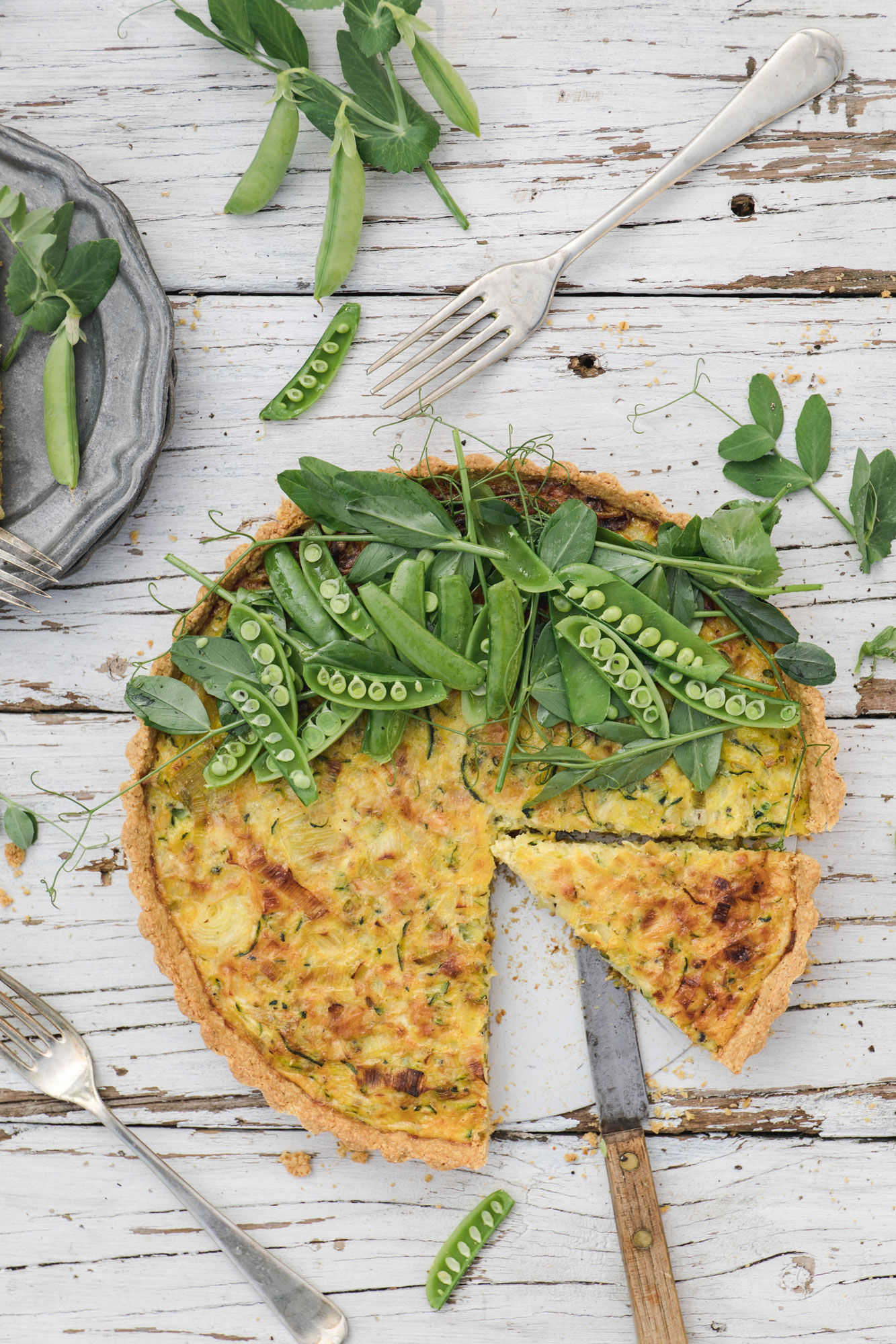 gluten free and vegetarian summer picnic tart with leek, cheddar and zucchini
