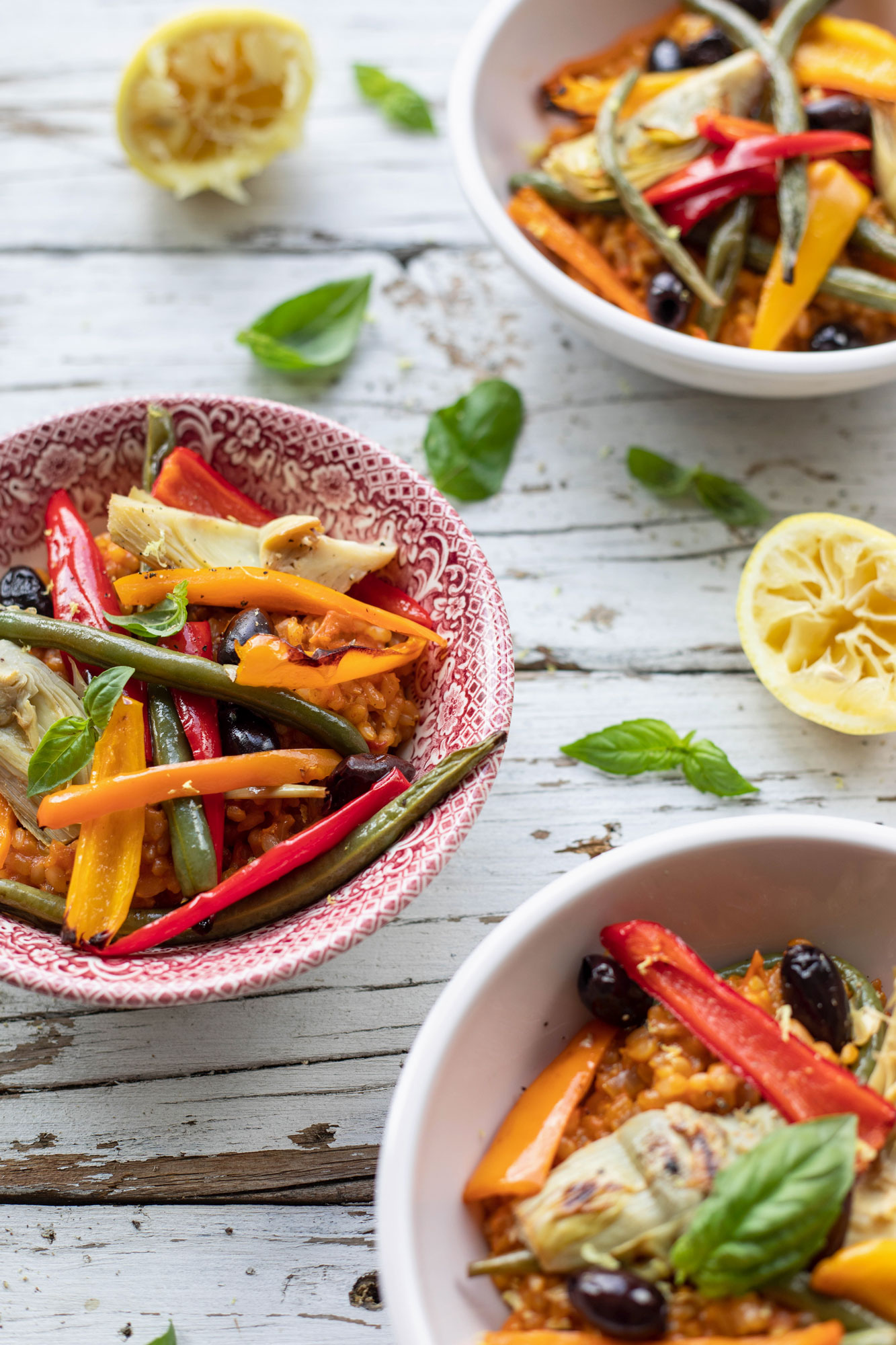 vegetarian paella with roasted peppers, olives, artichokes and beans