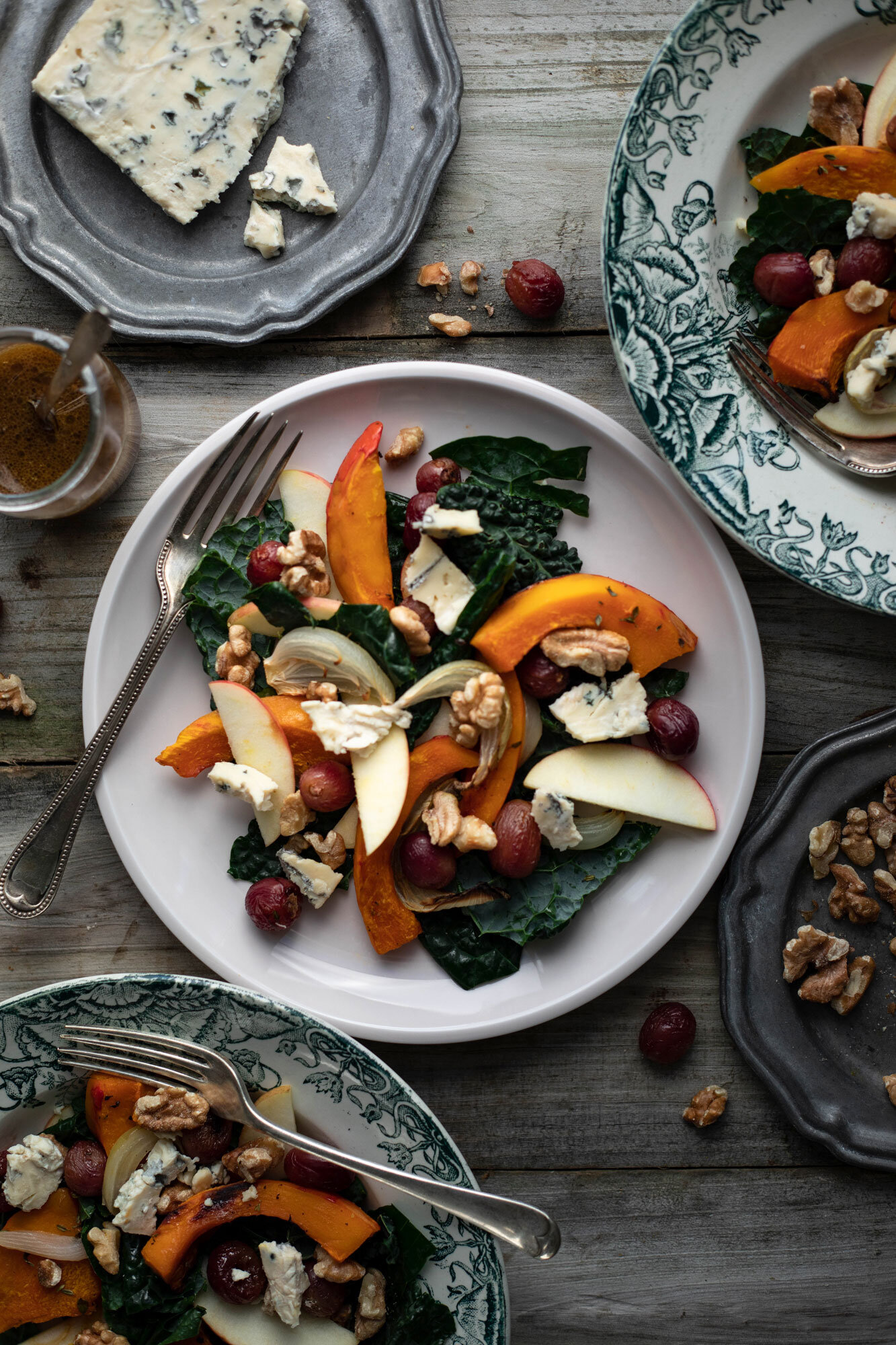 Autumn tray bake salad with roasted grapes, squash and blue cheese
