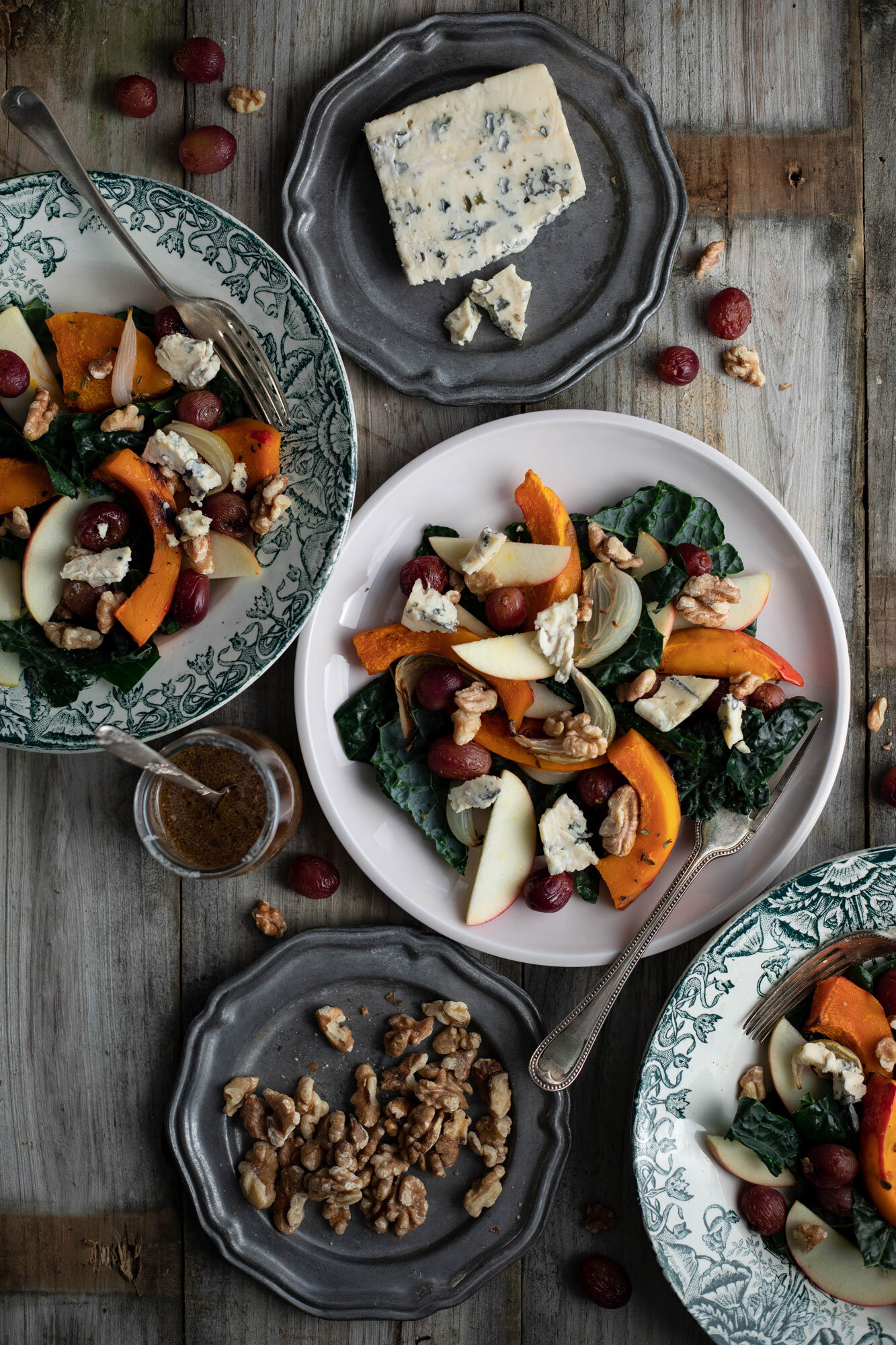 Autumn tray bake salad with squash, roasted grapes, blue cheese and kale