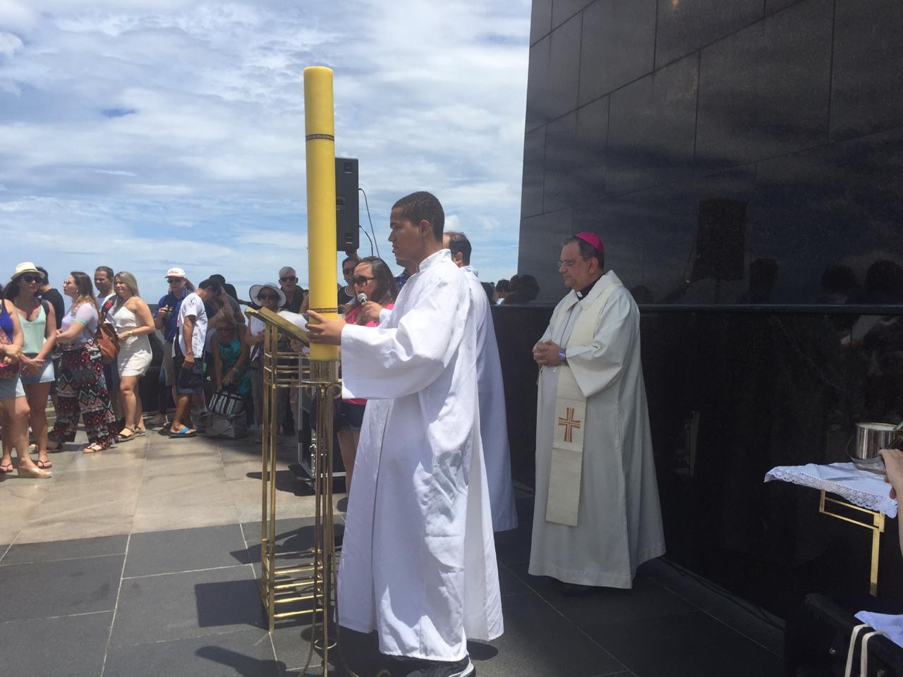 Mass being officiated in Portuguese by priests at Christo Redentor in Brazil.