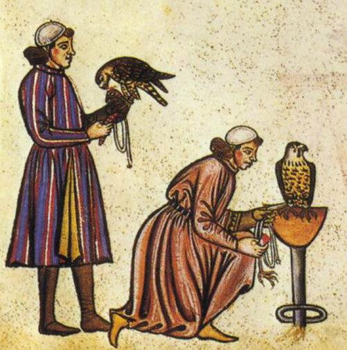 Detail of two falconers. Illustration from  De arte venandi cum avibus . Ms. Pal. Lat. 1071, Biblioteca Apostolica Vaticana.  Credit: Wikipedia -    Falconry