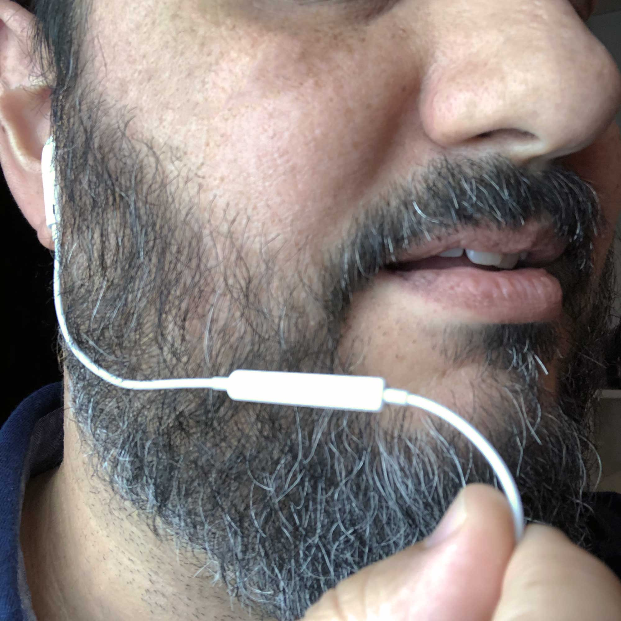 Hold the earbud cable below the microphone up near your cheek to the side of your mouth to get a better sound while preventing breath noise.