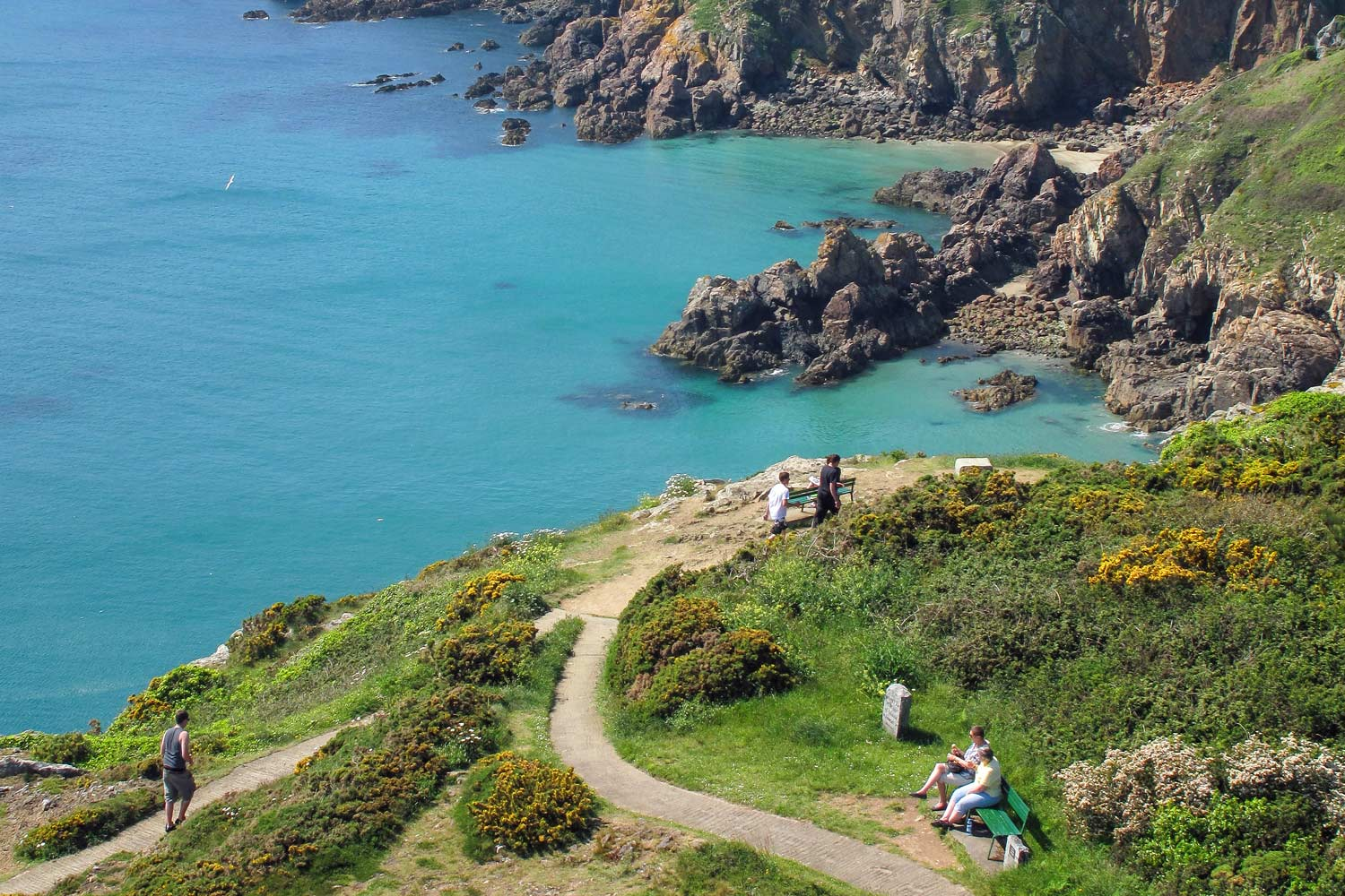 Guernsey's cliffs - The cliffs are awash with flowering plants in spring, but at any time of year, the well marked paths with benches ensure you can walk as far as you like and always find a place to stop and rest to admire the views.
