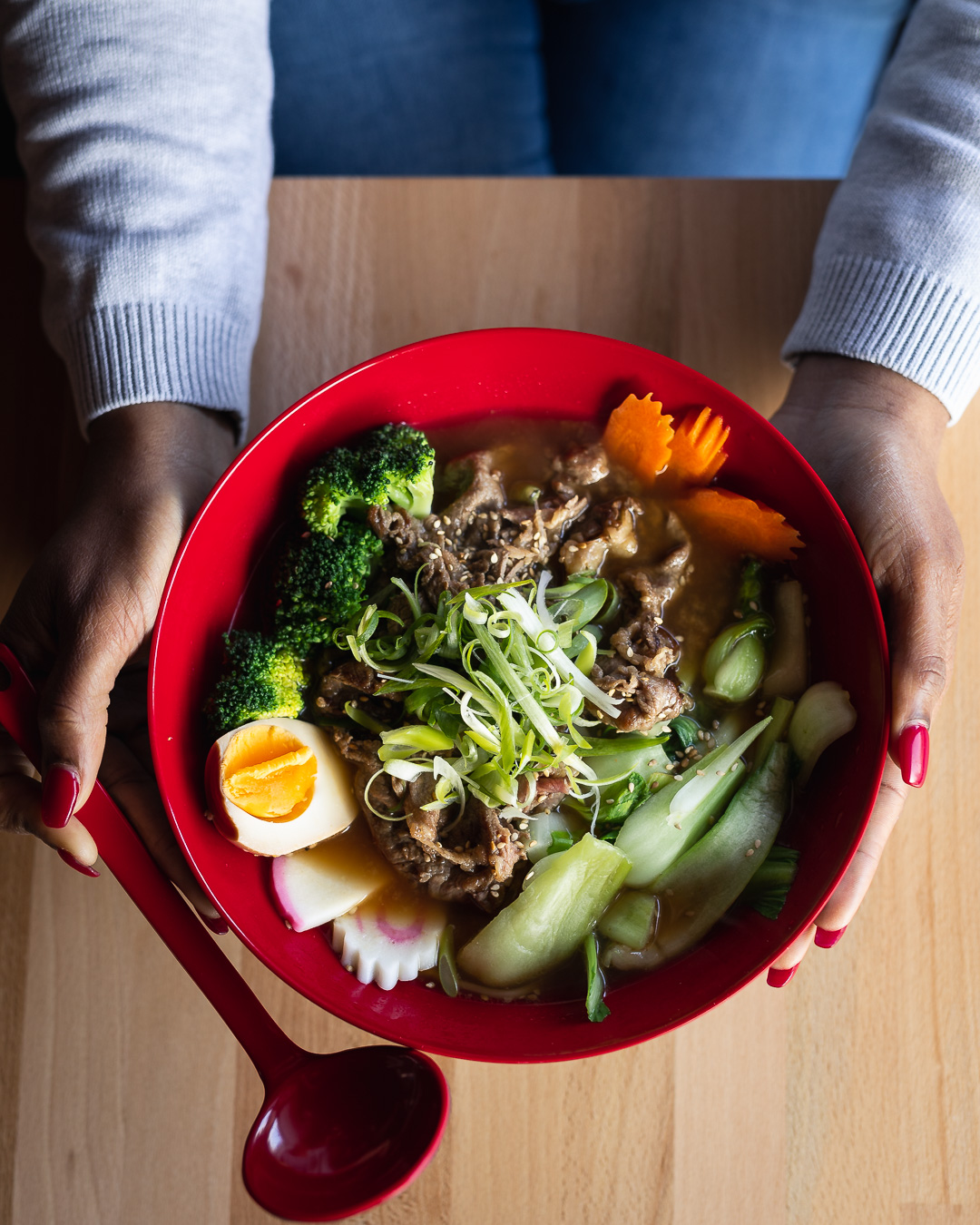 Restaurant photographer - Kamile Kave - Customer holding Poke Bowl at Sushi & Poke Restaurant.jpg