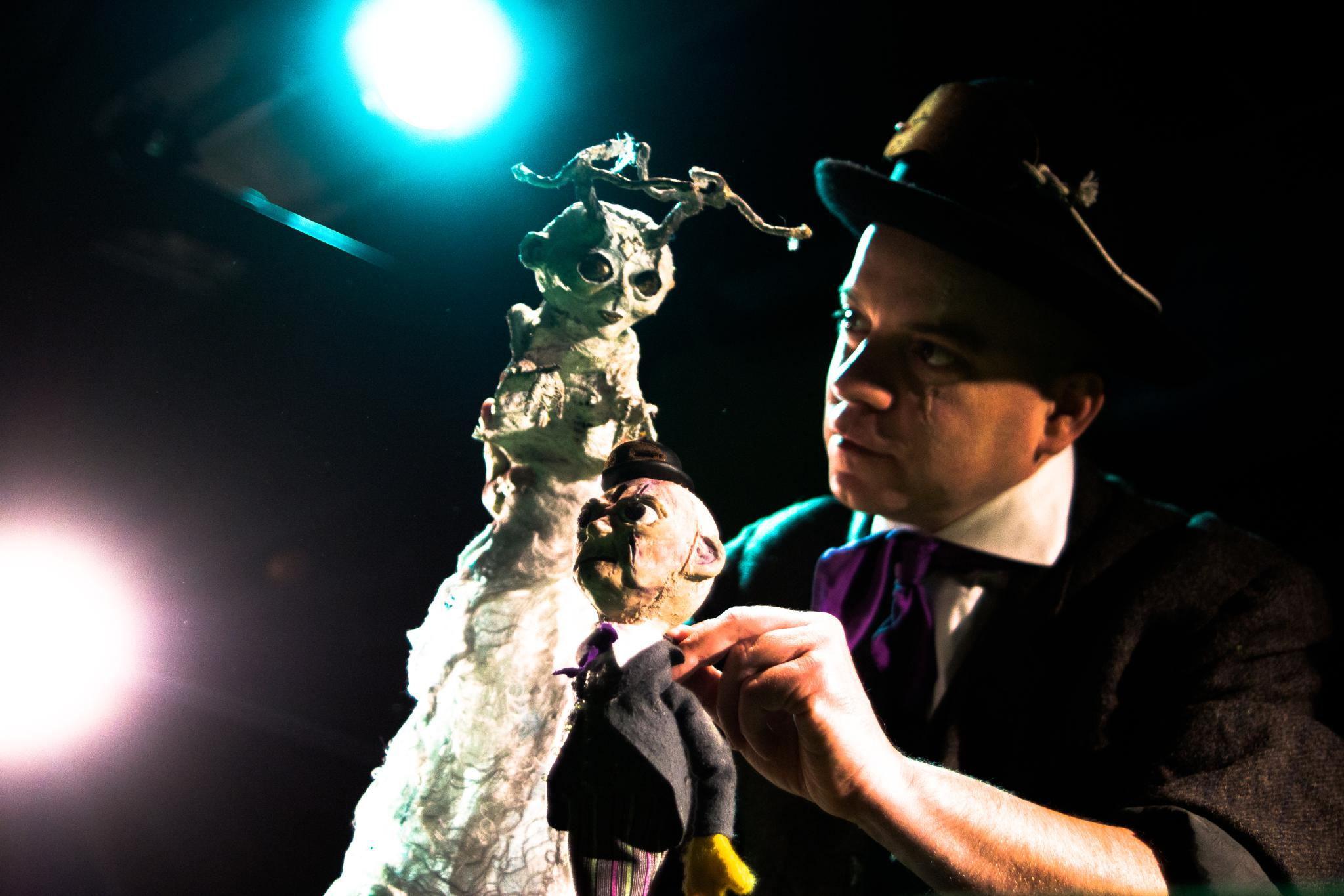 Eric Woolfe uses puppets and close-up magic based on the Faust Legend to tell an eerie tale of unholy larceny and Klondike gold.