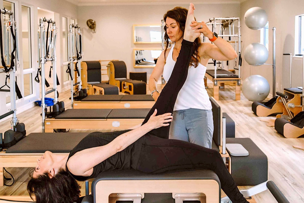 Private+Pilates+Classes+in+Houston+by+The+Breathing+Room+%7C+woman+on+BASI+machine