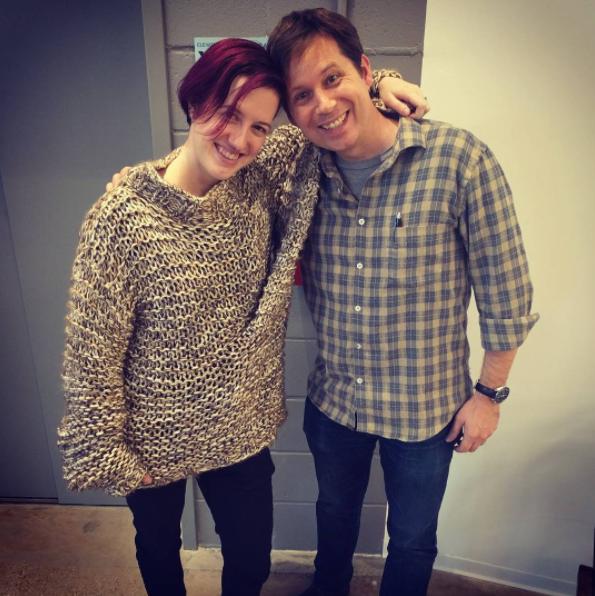 Ryn wearing the three-armed-sweater, with John Allspaw.