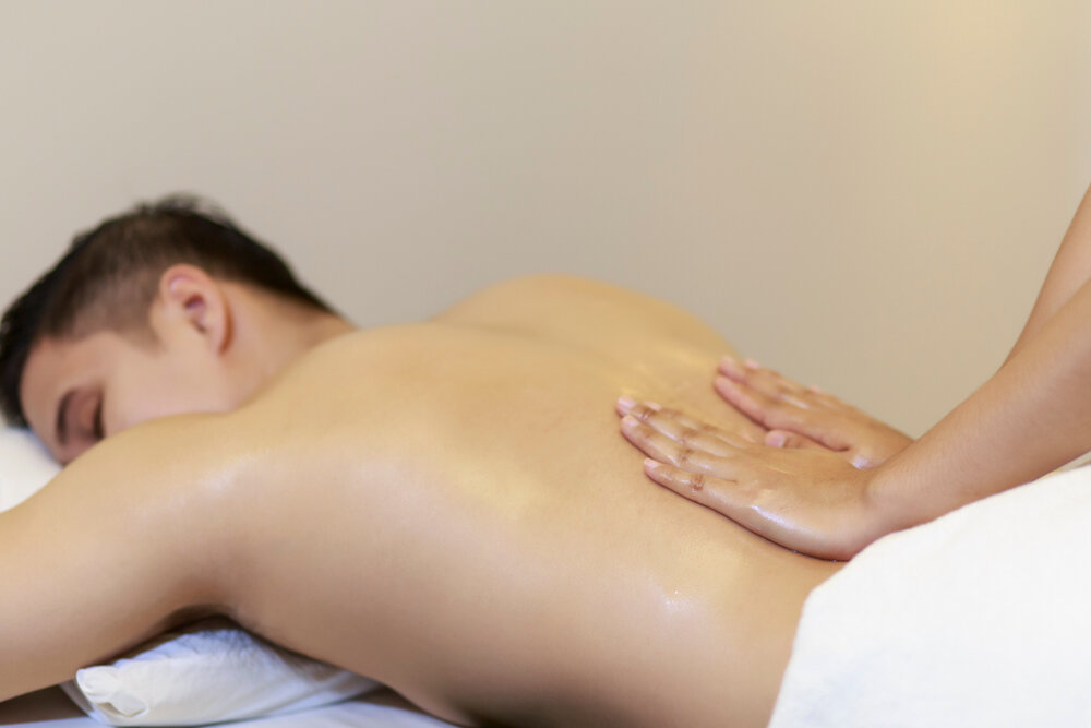 A man lying on a bed and taking spa