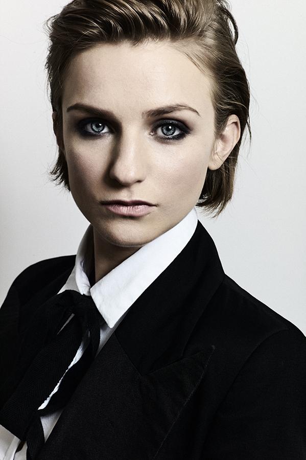 Faye wears black jacket by Paola Balzano, white Oxford collar shirt by Lee Paton, black ribbon tie stylist's own