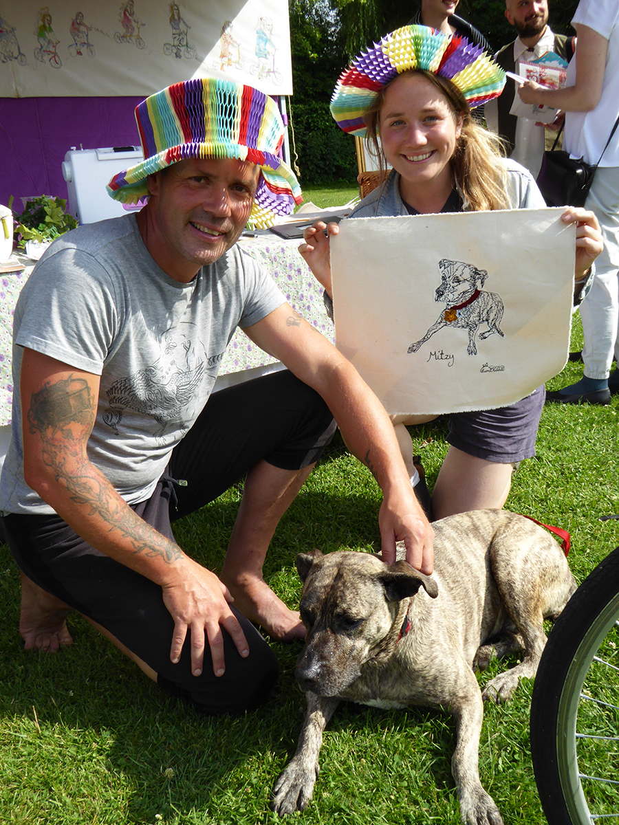 Harriet Riddell with Steven Little and canine portrait sitter Mitzy at Winchester Hat Fair, 2019, Photograph by Dr Birgitta Huse