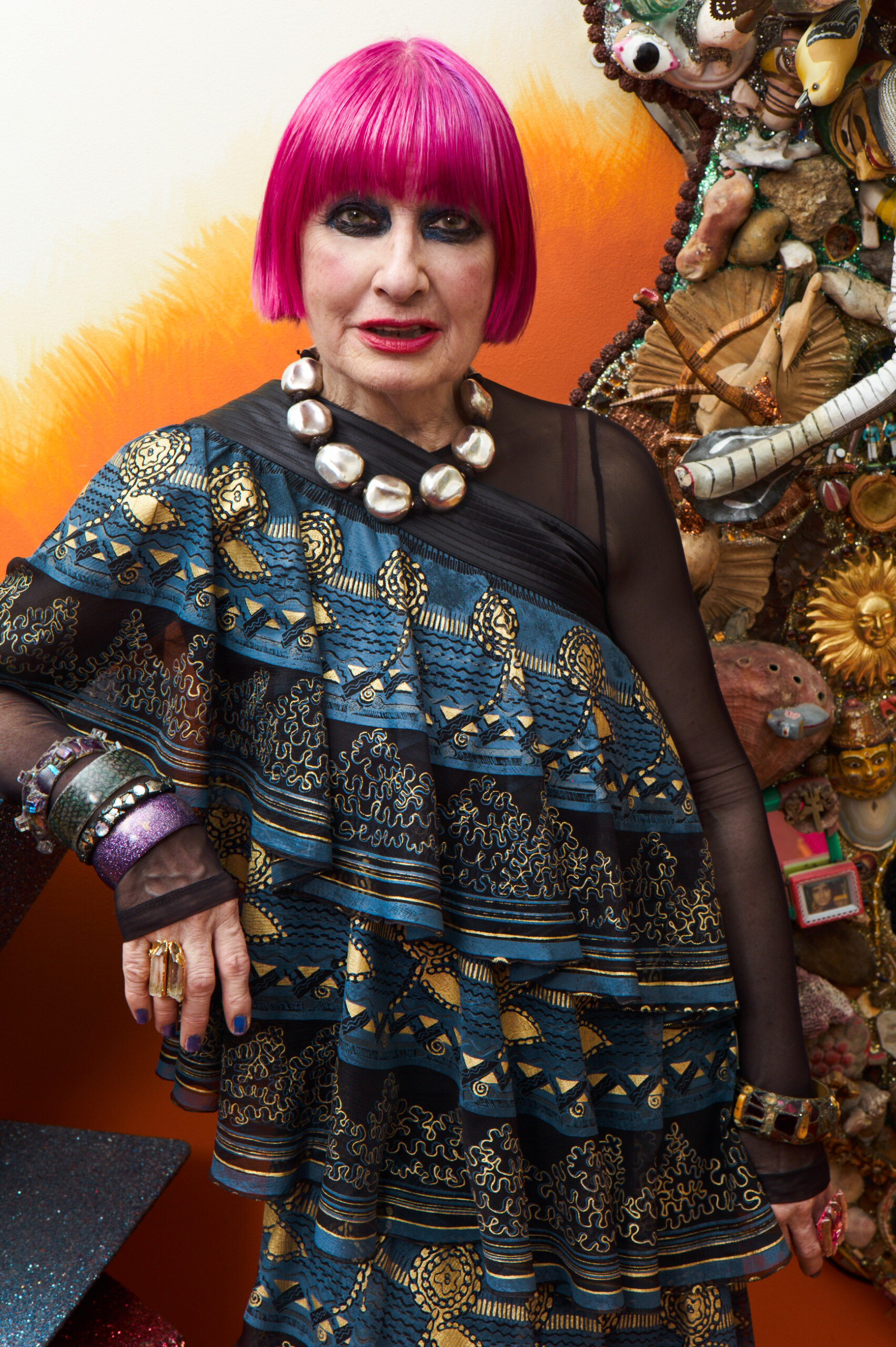 """Zandra Rhodes wearing a piece of her A/W16 """"Songket Brocade"""" collection with the """"Knitted Circle"""" design style 16/157, photographed in her home by Ram Shergill"""