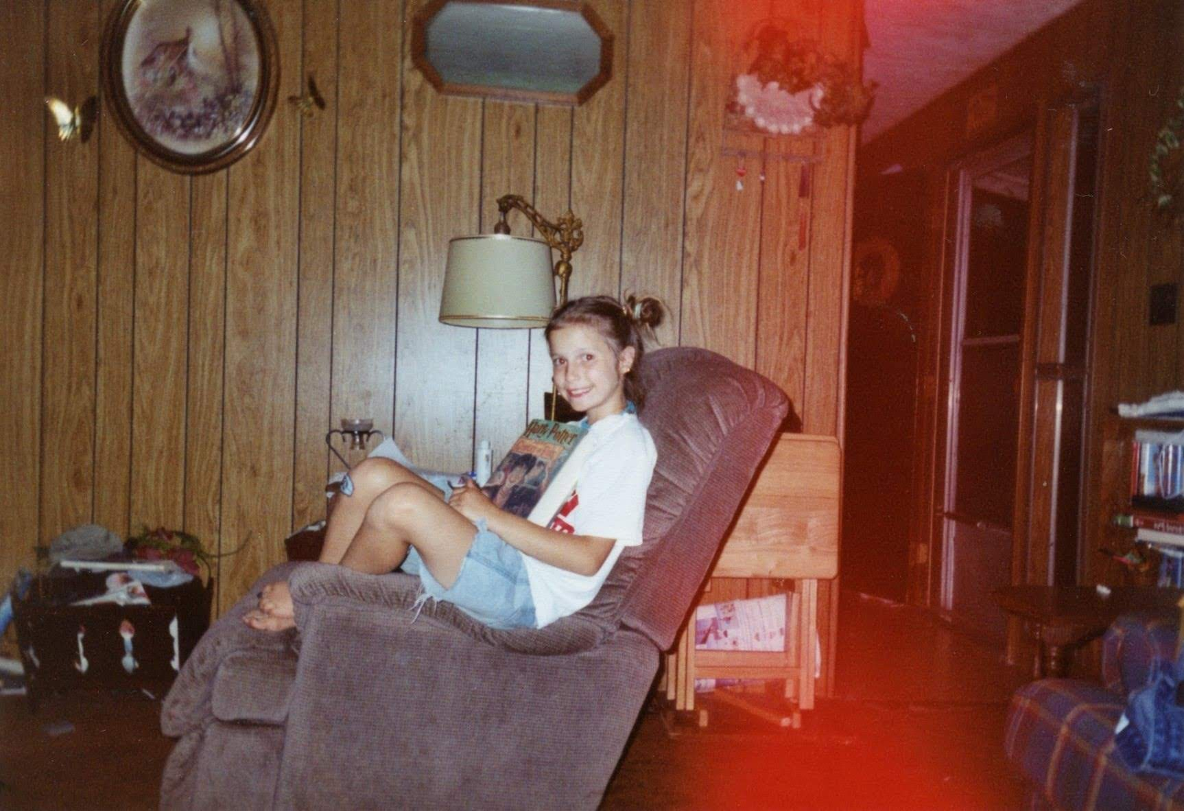 9-year-old me reading  Harry Potter and the Goblet of Fire  for the first time. This photo also stands as evidence that I started sitting on chairs in odd ways very young.