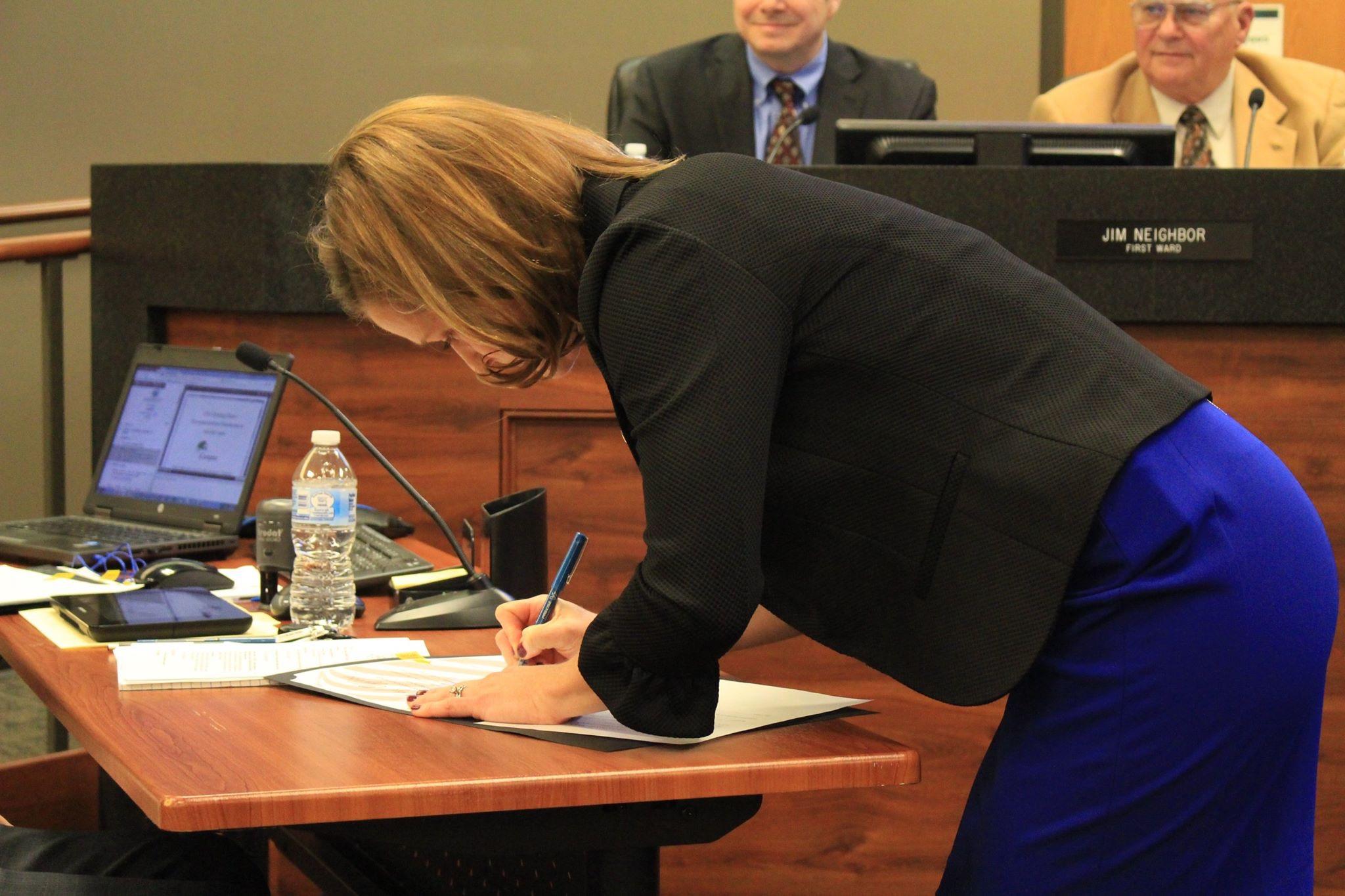 Lindsey signing a bill.