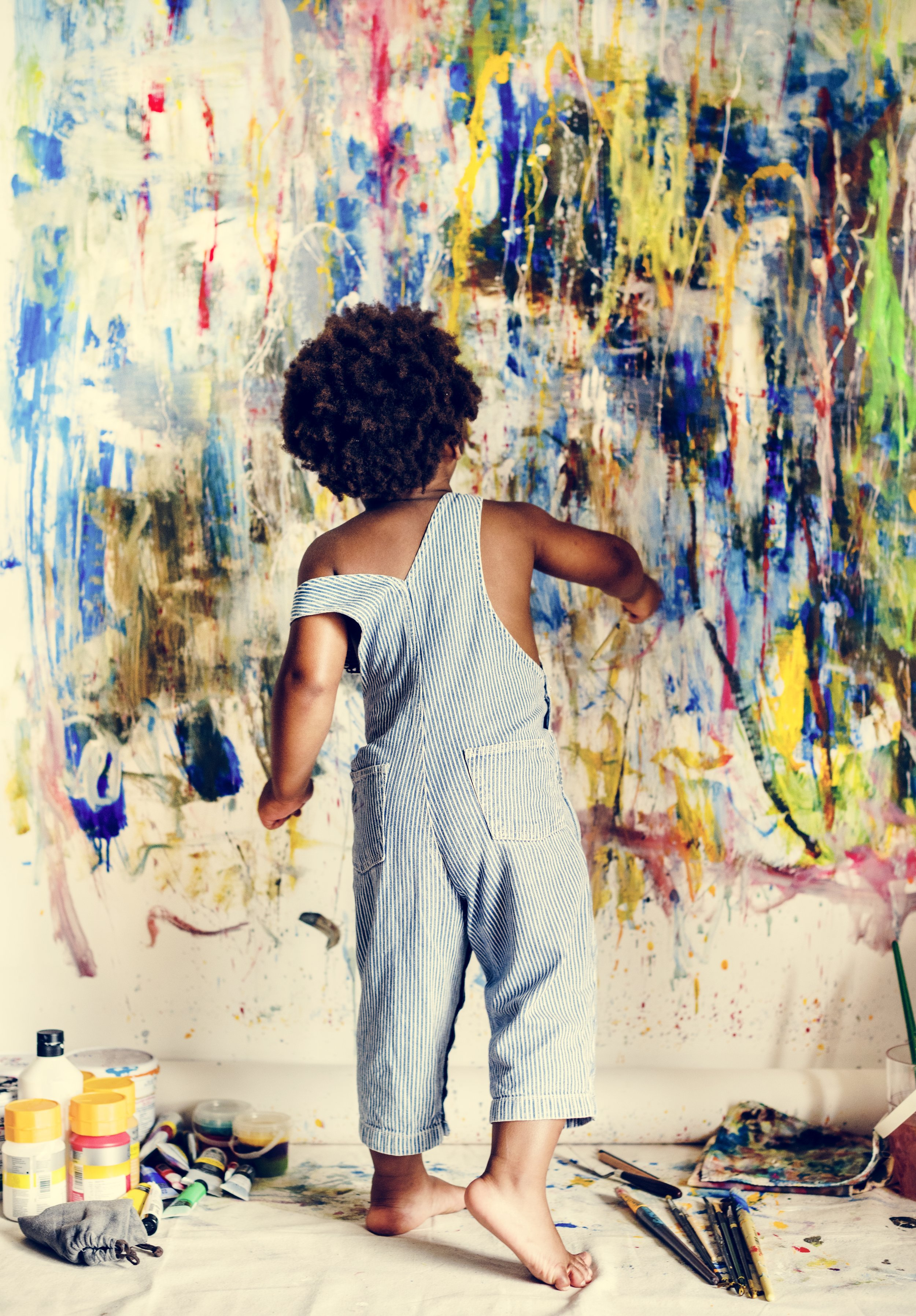 black-kid-enjoying-his-painting-PNBUDGV.jpg