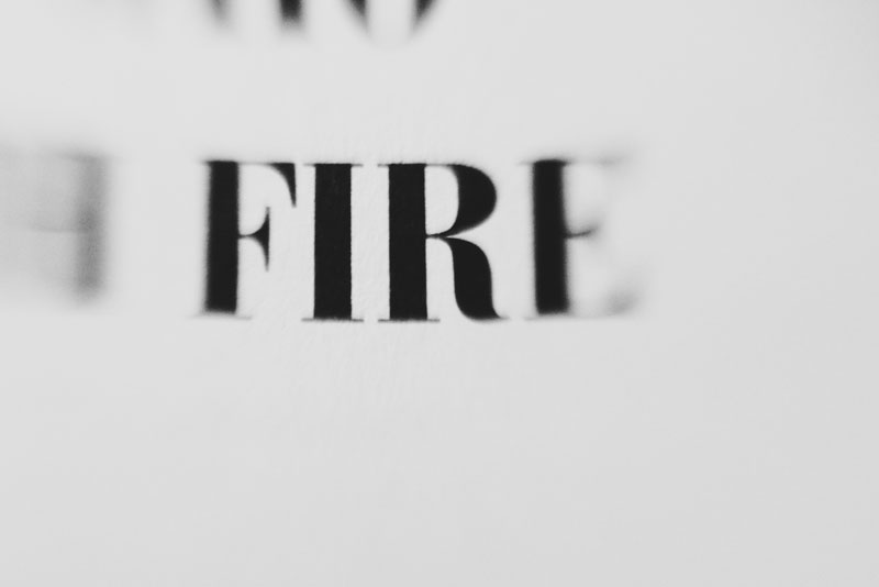 Monica-Galvan-photography_black-and-white_typography-words-lensbaby_fire