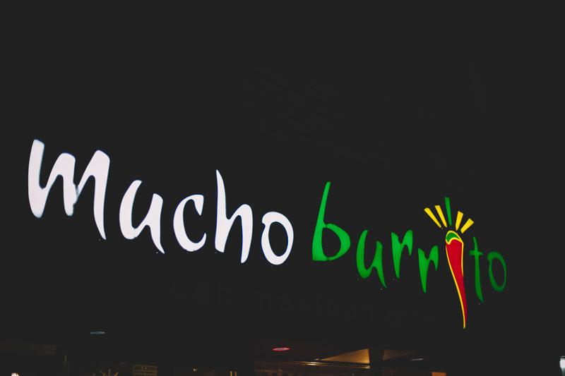 Mucho Burrito restaurant signage West End Vancouver BC