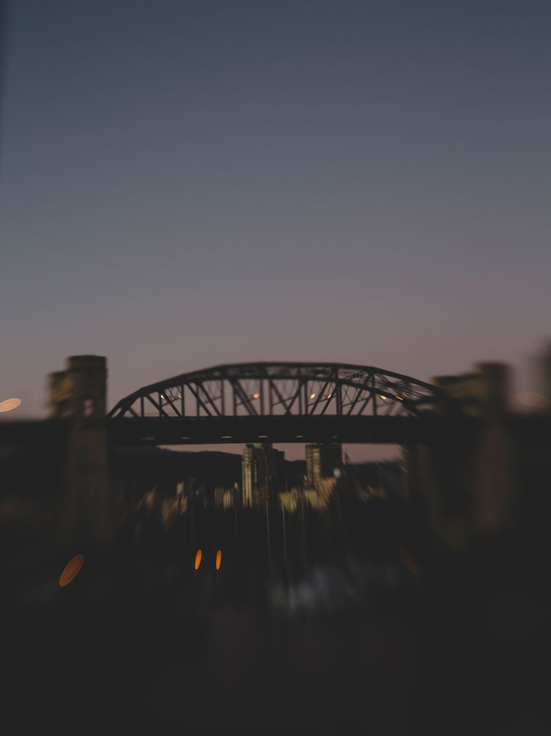 Lensbaby photography Vancouver's Burrard Bridge at dusk