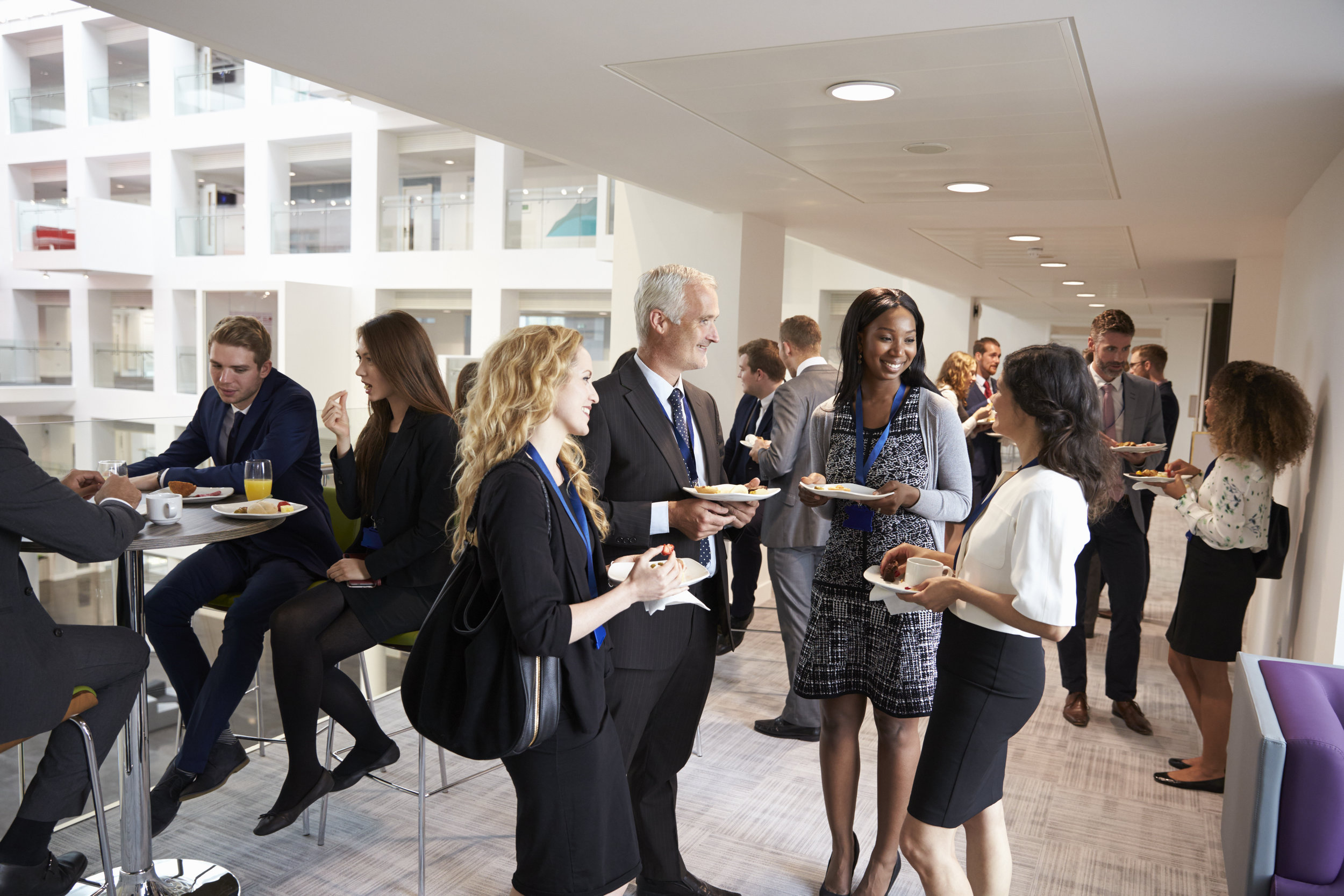 delegates-networking-during-conference-lunch-PTQSYZV.jpg