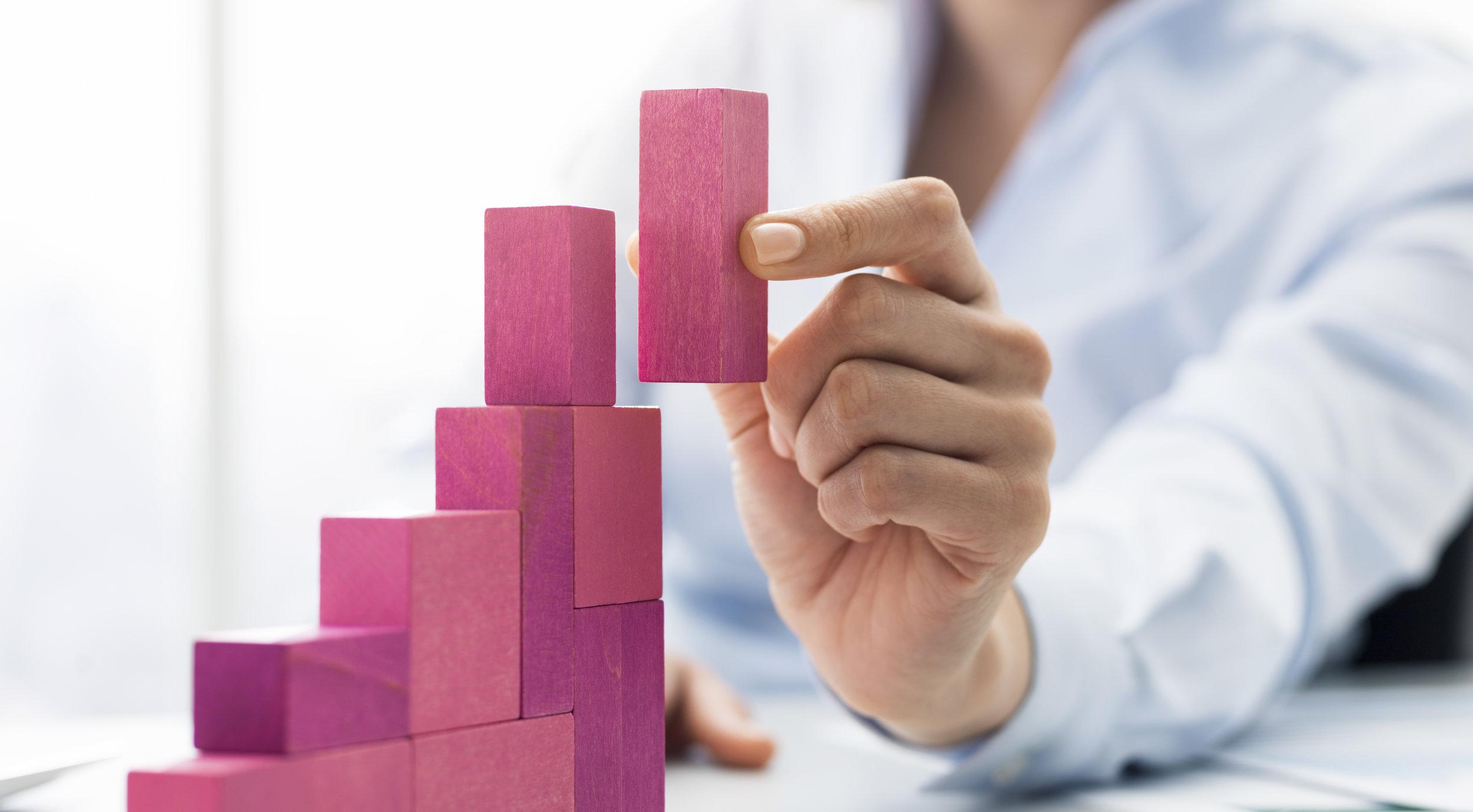 businesswoman-building-a-growing-financial-chart-YDS3QJ5.jpg