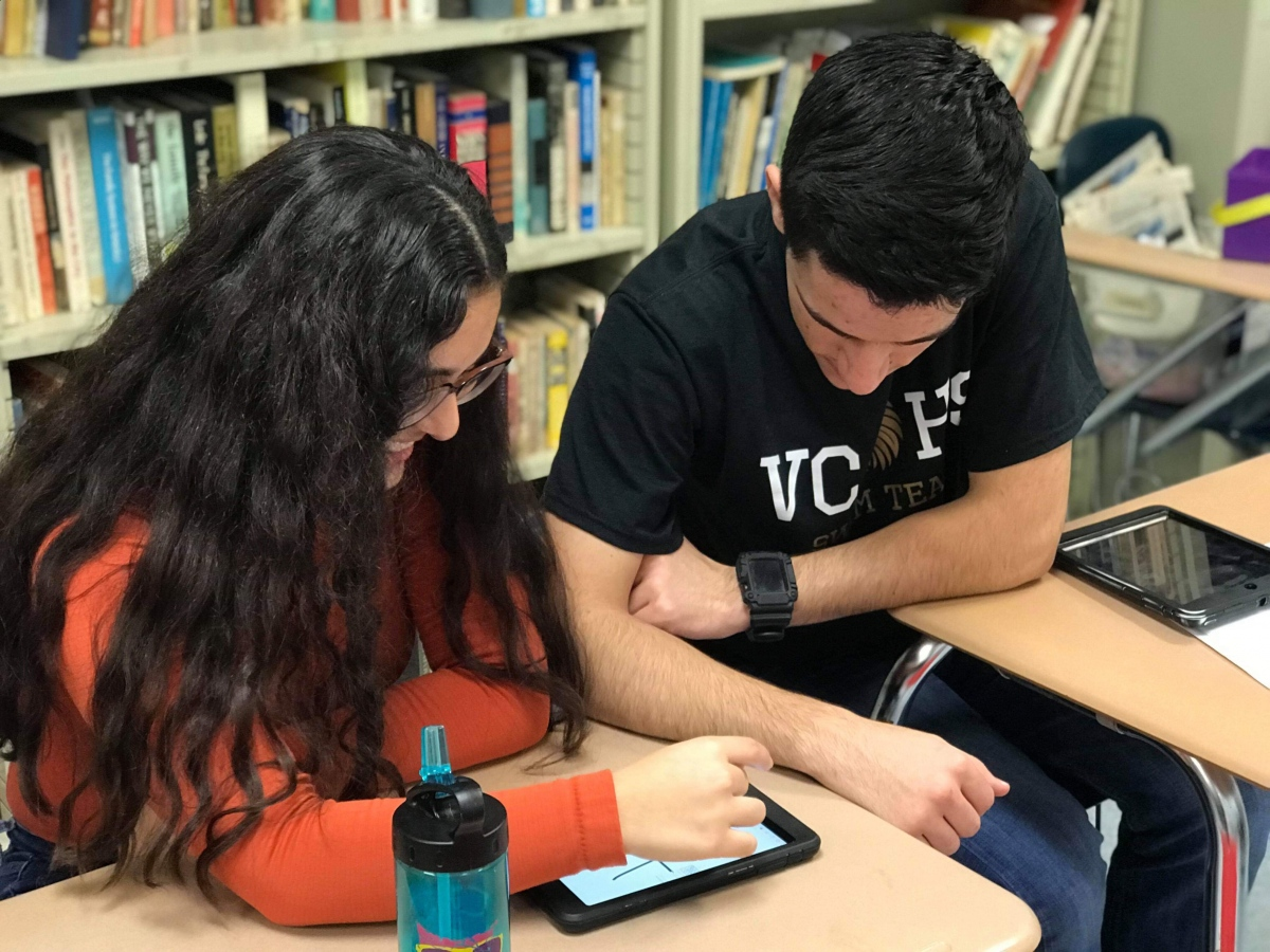 Lesli and Steven reading.jpg