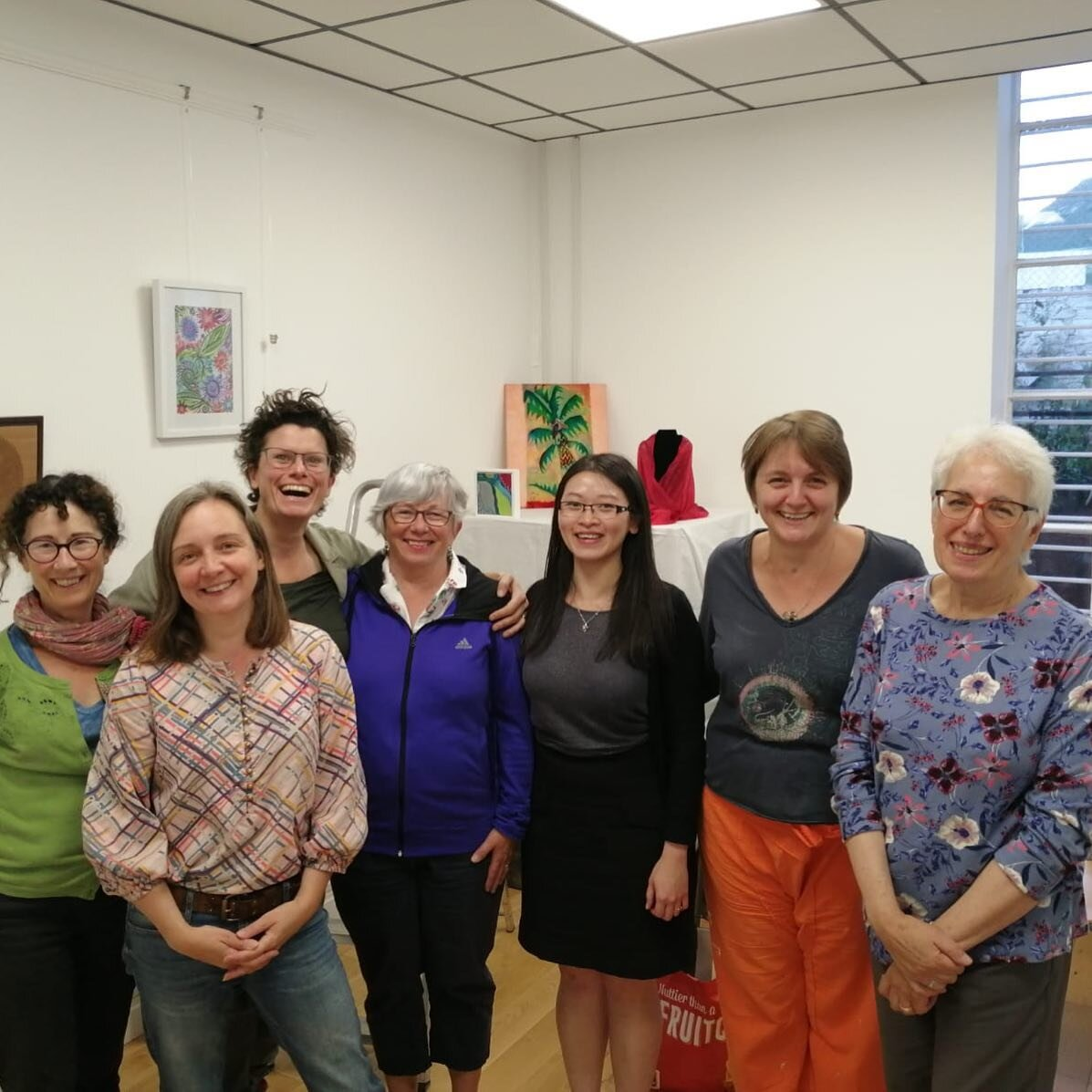 Barnet Artists taking a break from hanging our exhibition at Compass Residential