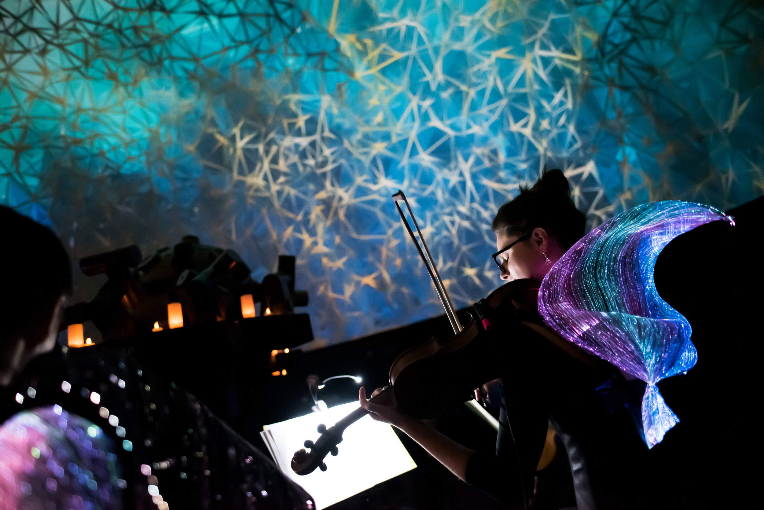 """Dome visuals and garments by Neoperceptions during the """"Synesthesia Suite"""" concert in Museum of Science, Boston on April 4th, 2019. Image taken by Jonathan Beckley."""