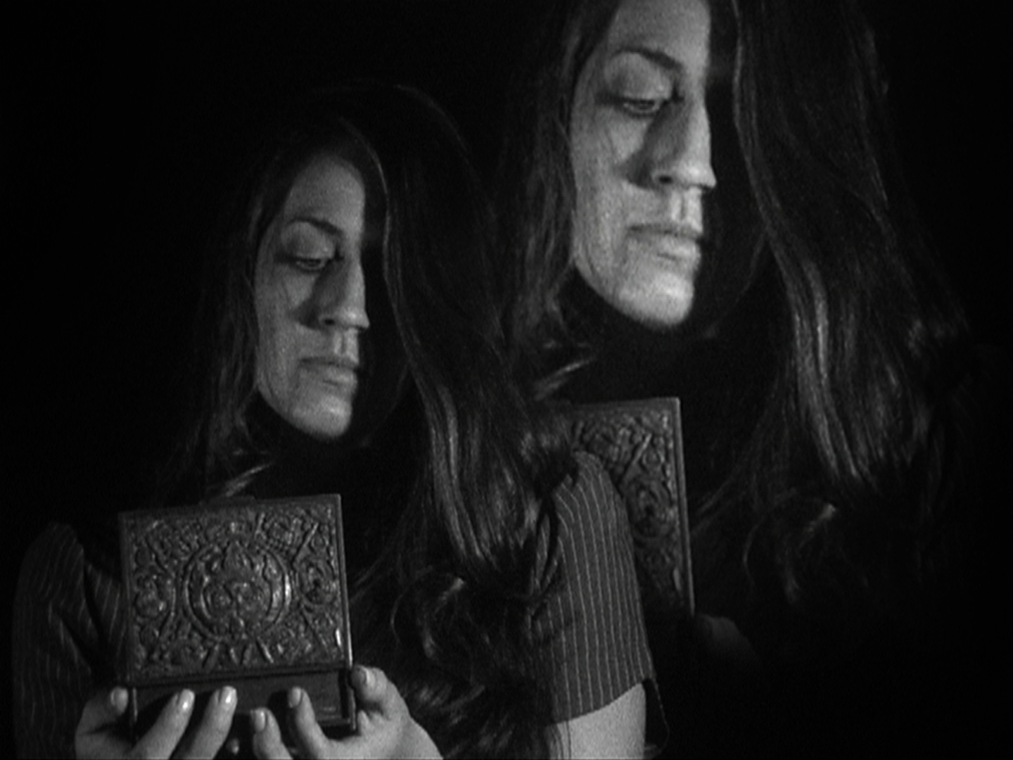 The Box - A girl is trapped in a box - or, is she? This 16mm/HD, surrealist short follows Luna as she listlessly travels through different environments, trying to find a way out of