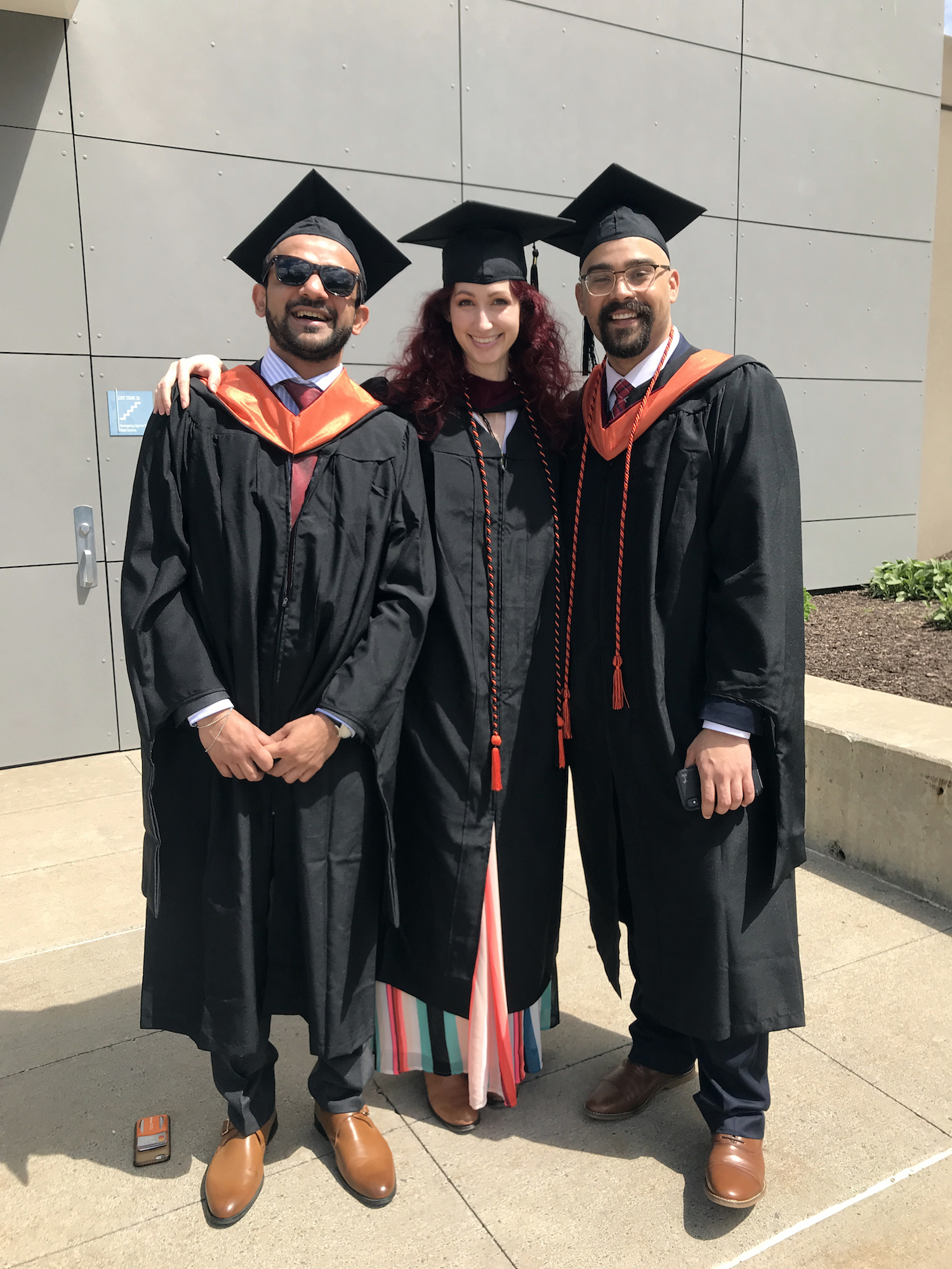Geena Matuson with fellow Syracuse University Newhouse Masters students Mo Nomani and Tyler Lowell on graduation day, May 2019.