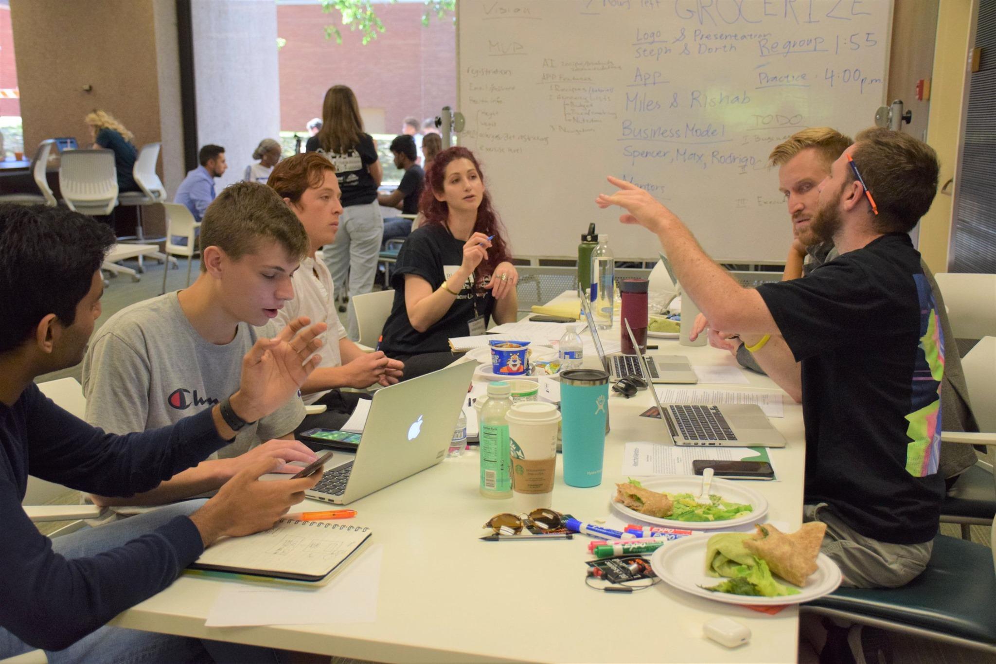 Geena Matuson (@geenamatuson) as mentor with the team behind Grocerize for Startup Weekend, 2019.