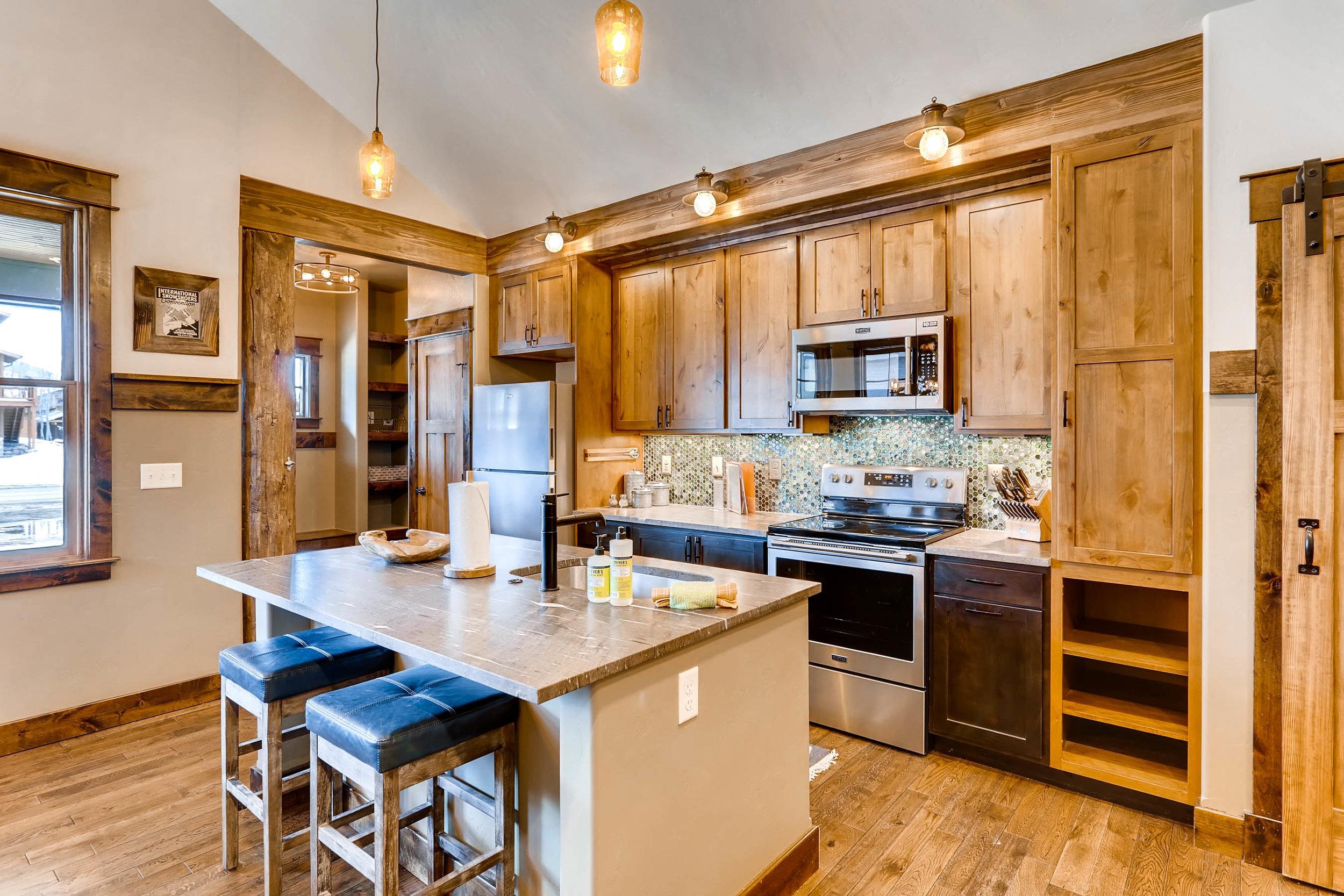 909 Park Ave Grand Lake CO-print-015-8-Kitchen-2700x1800-300dpi.jpg