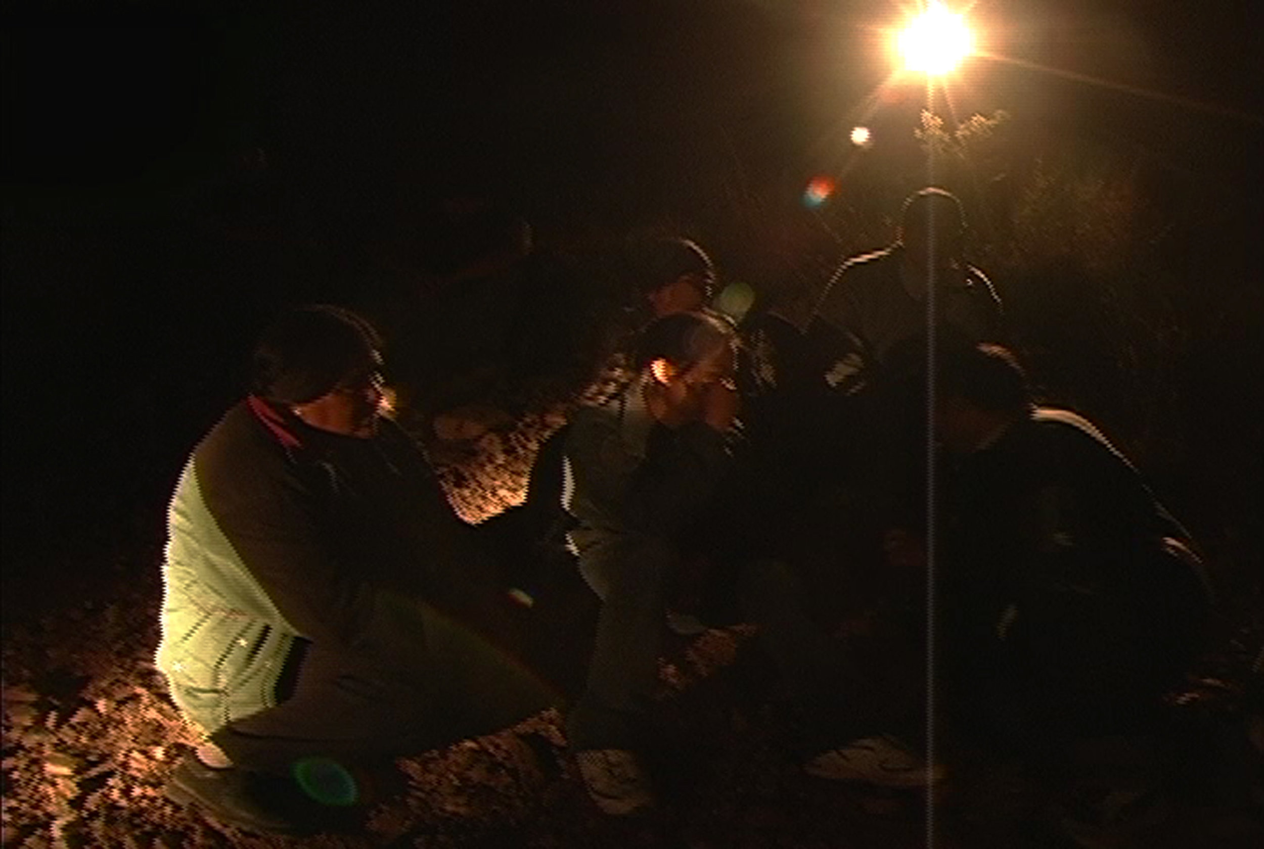 migrants in flashlights1.jpg