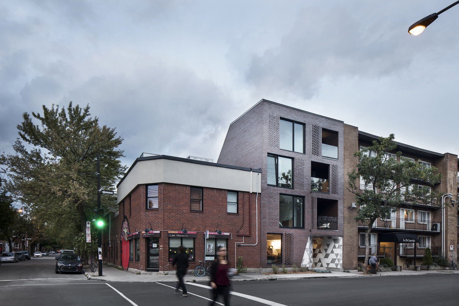 A new building next to an existing commercial space in Montreal, via  ArchDaily
