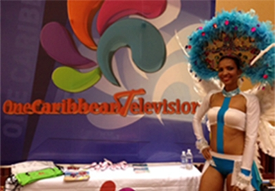One Caribbean Television's festive exhibitor booth.