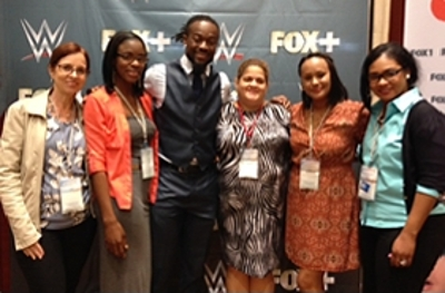 WWE pro wrestler Kofi Kingston poses with admirers at the CCTA Annual Meeting in Jamaica.