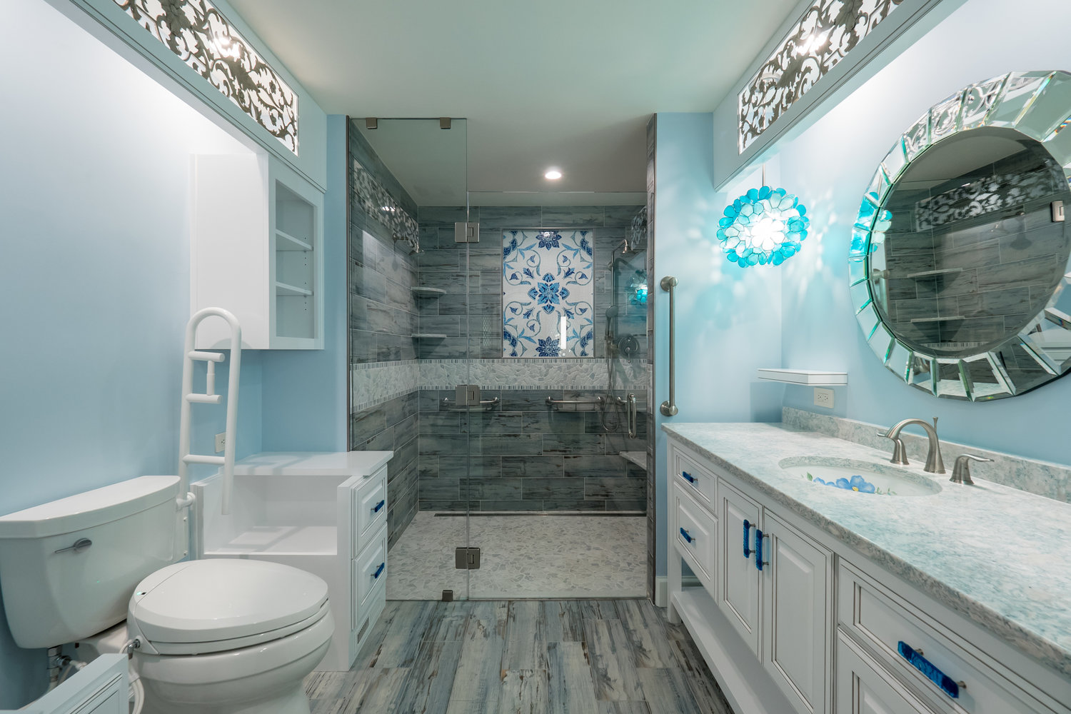Artful lighting + Mosiac Tile Bathroom -