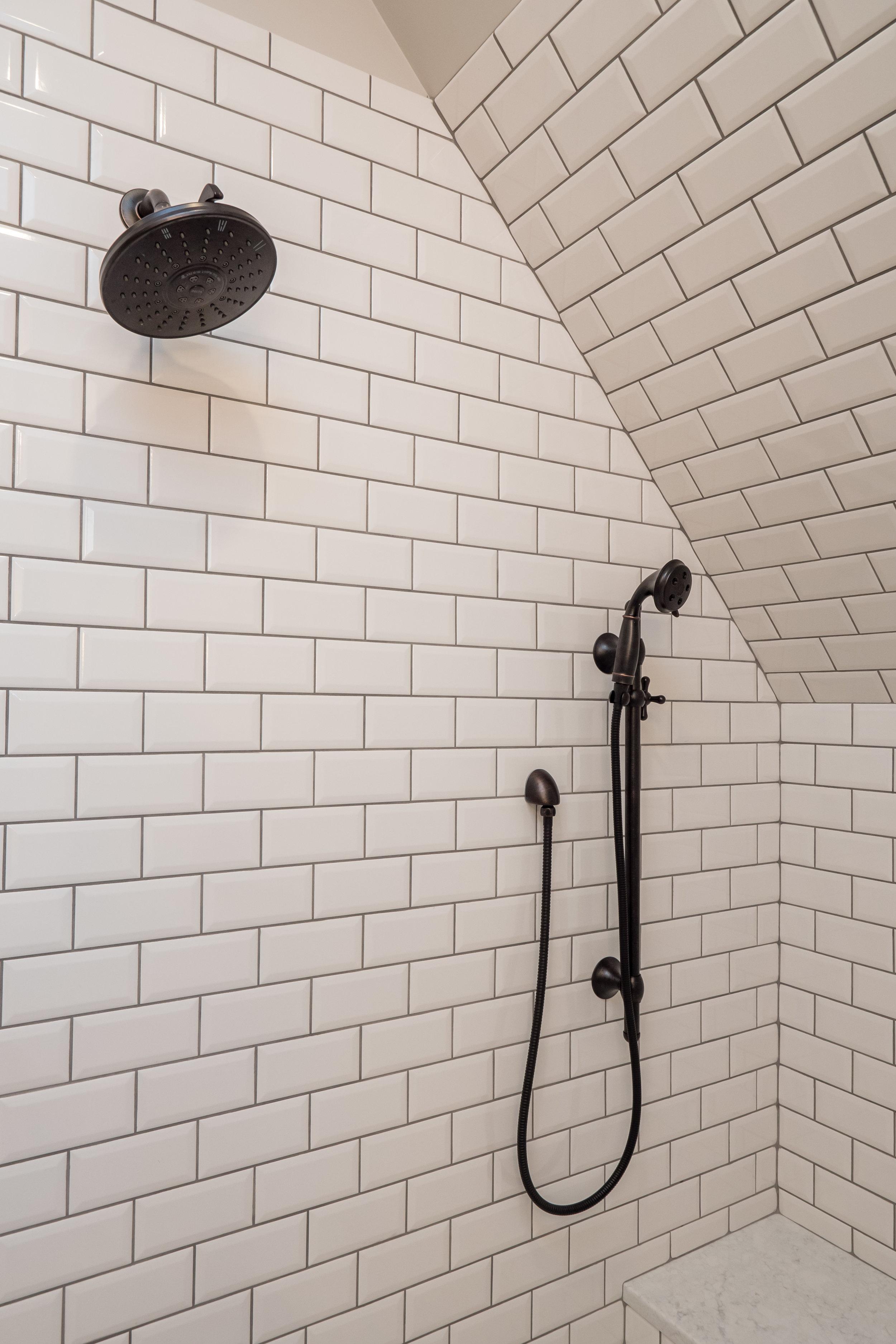 classy bathroom remodel + chesapeake + shower fixtures + white tile + benson Homes.jpg